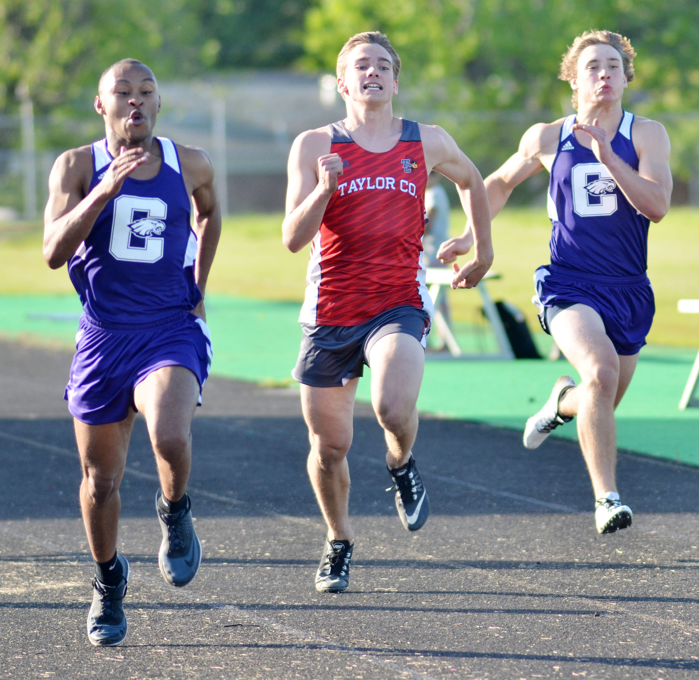 CHS sophomore Daesean Vancleave, at left, and classmate Tristan Johnson, at right, run the 100-meter dash.
