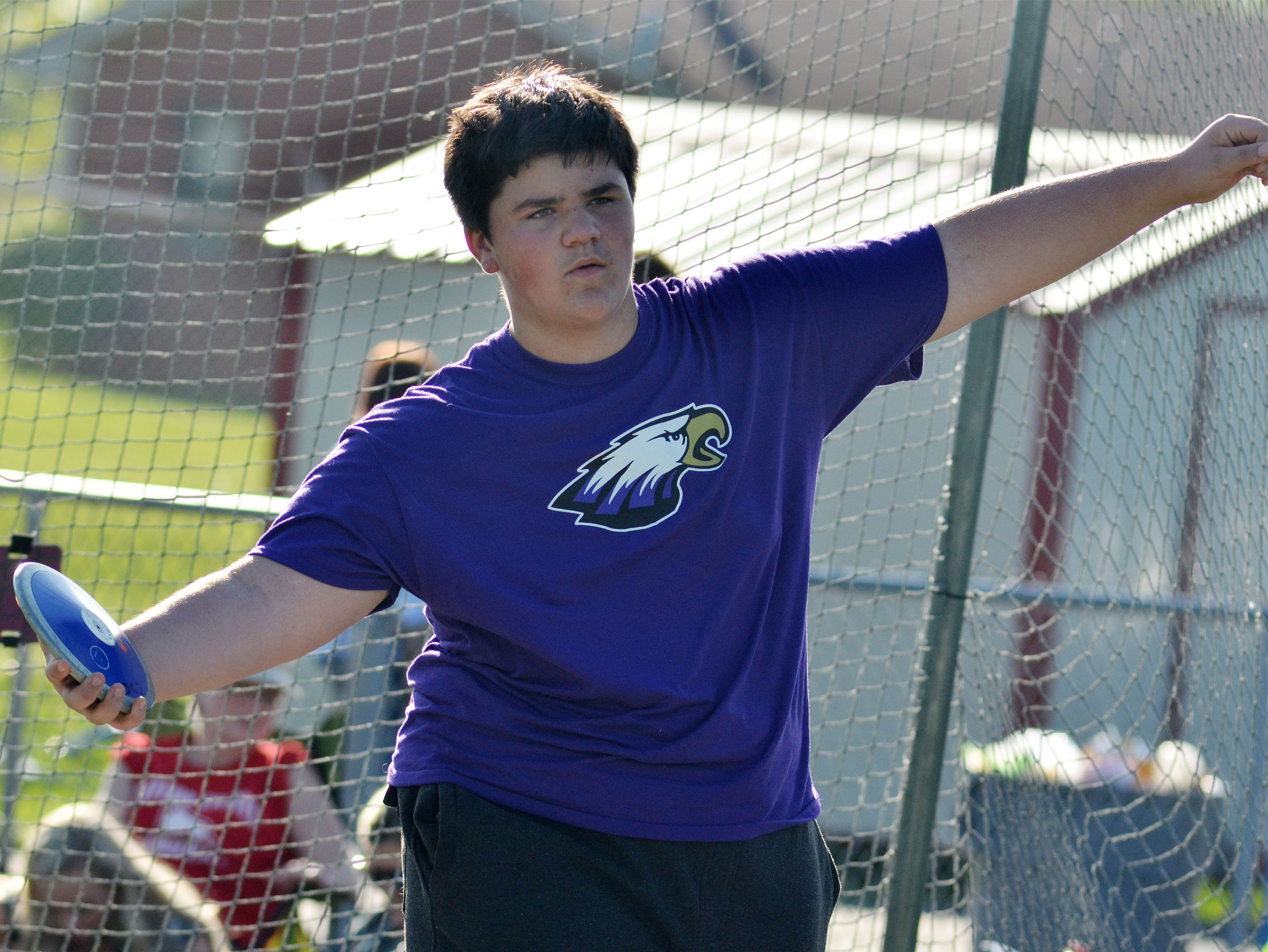 Campbellsville Middle School seventh-grader Logan Rakes throws shot put.
