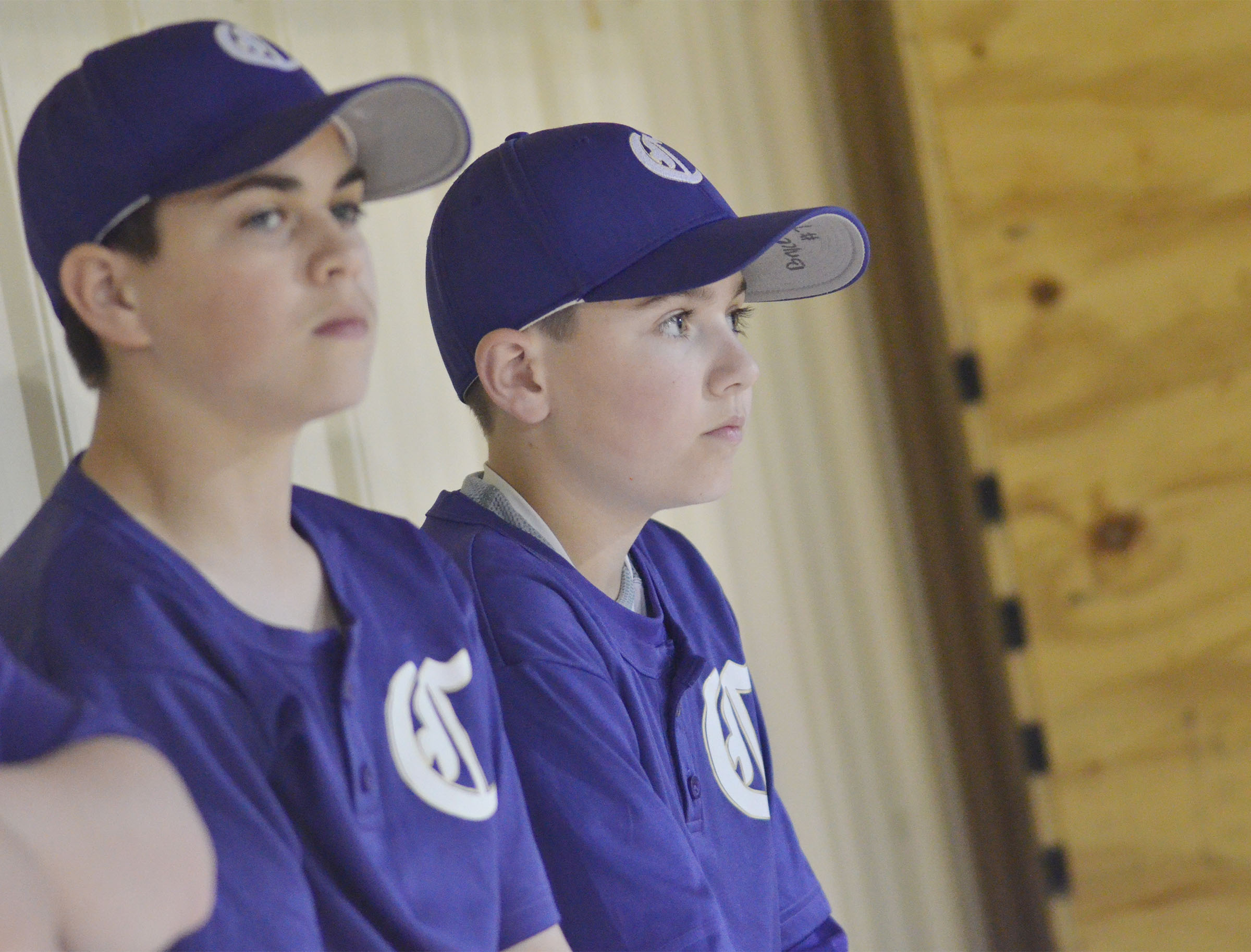 CMS eighth-grader Clark Kidwell, at left, and sixth-grader Bryce Newton watch as their teammates win.