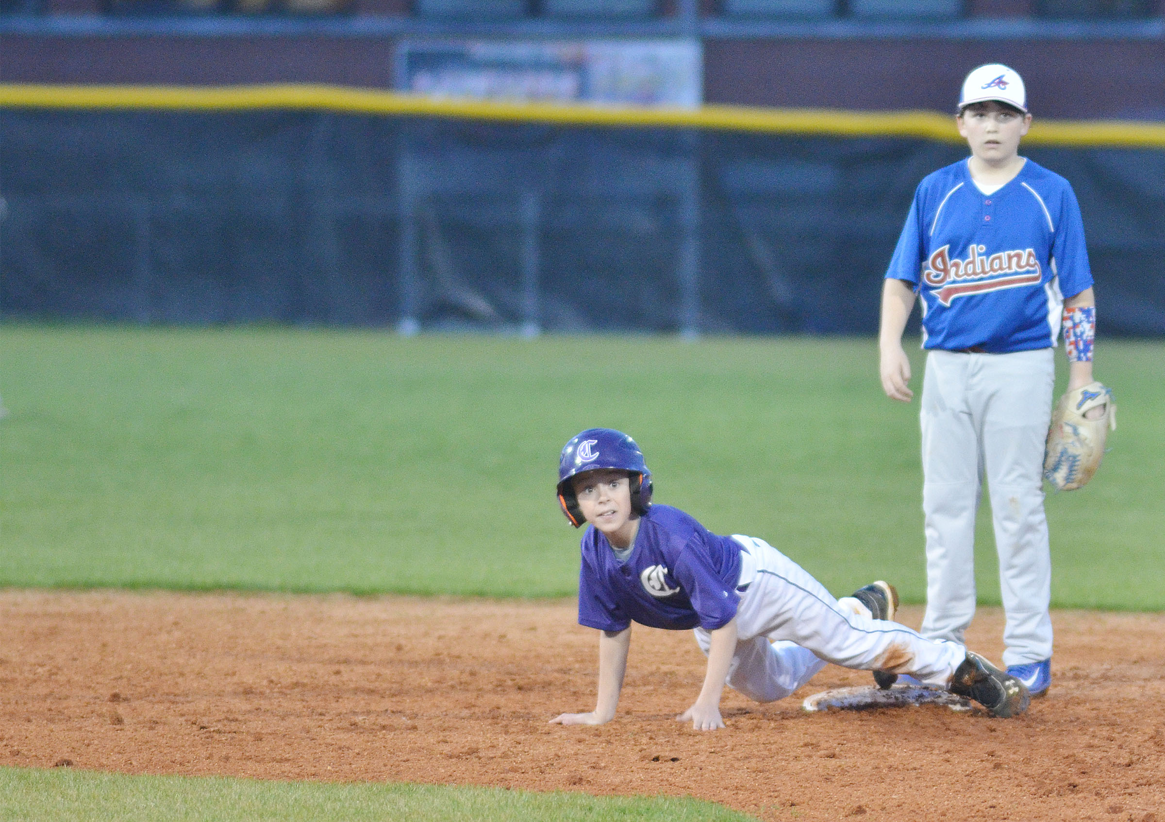 CMS sixth-grader Chase Hord slides at second.