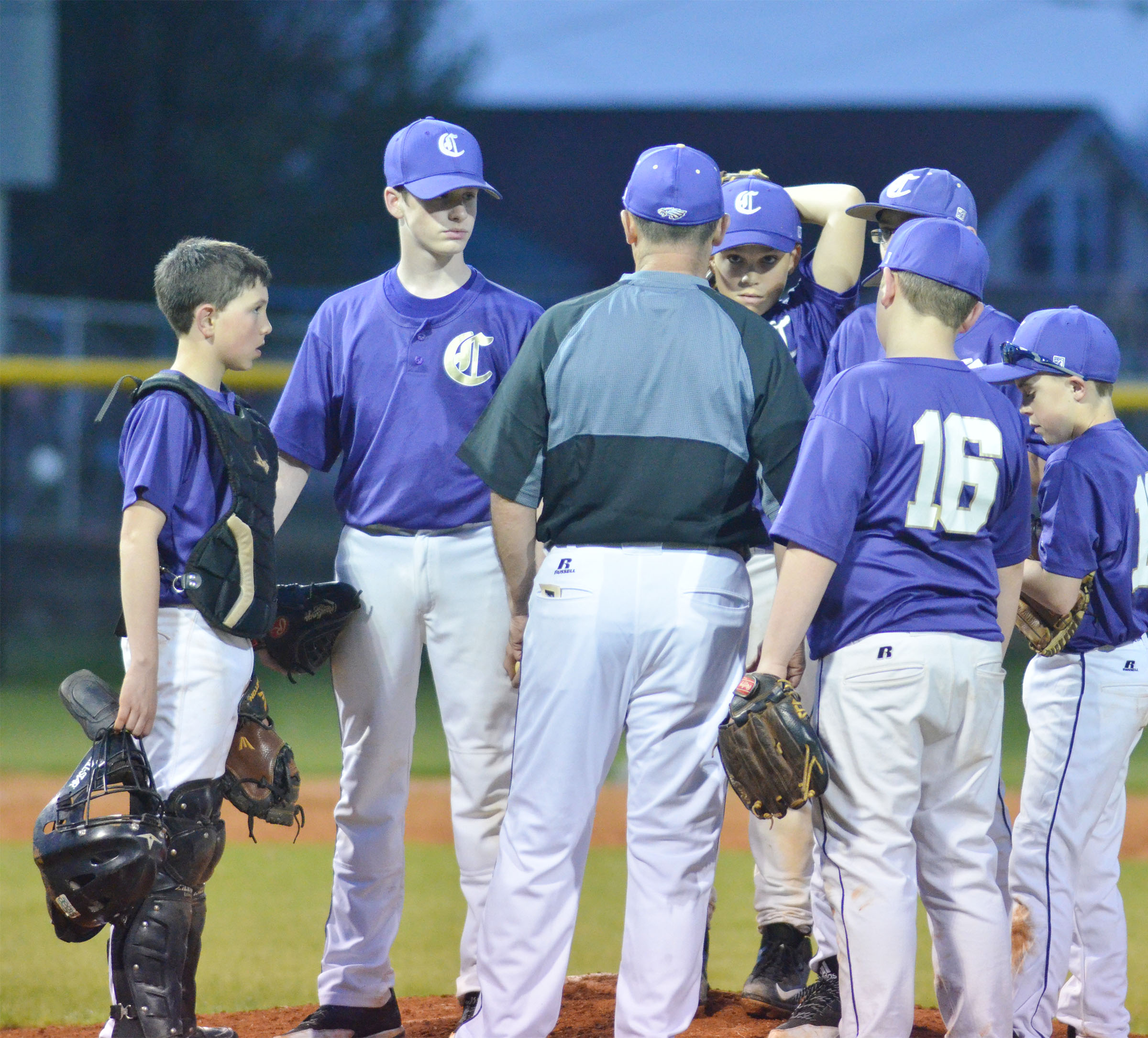 CMS head baseball coach Lynn Kearney talks with his players.