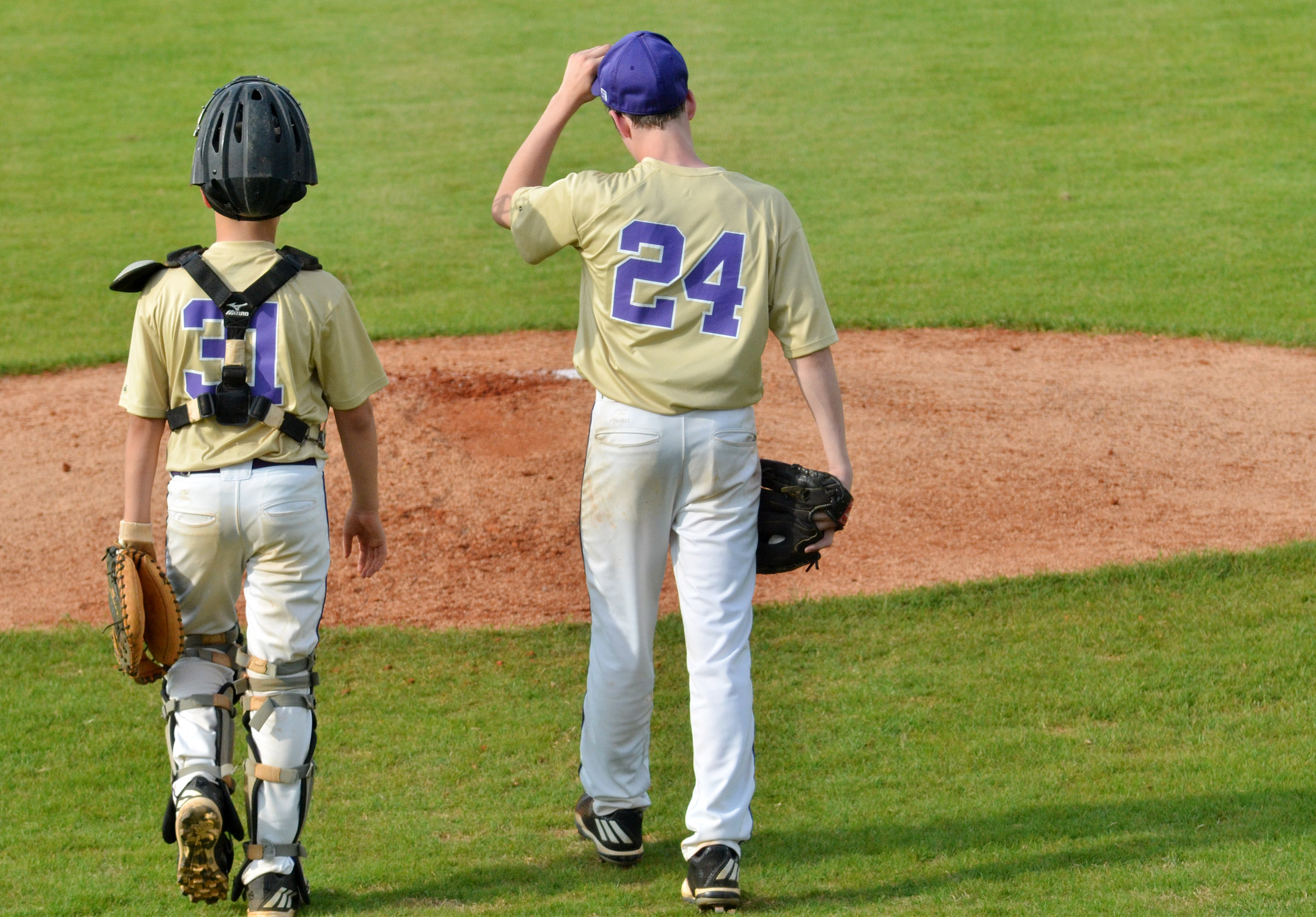 CMS sixth-grader Konner Forbis, at left, and seventh-grader Seth Hash walk to the pitcher's mound.