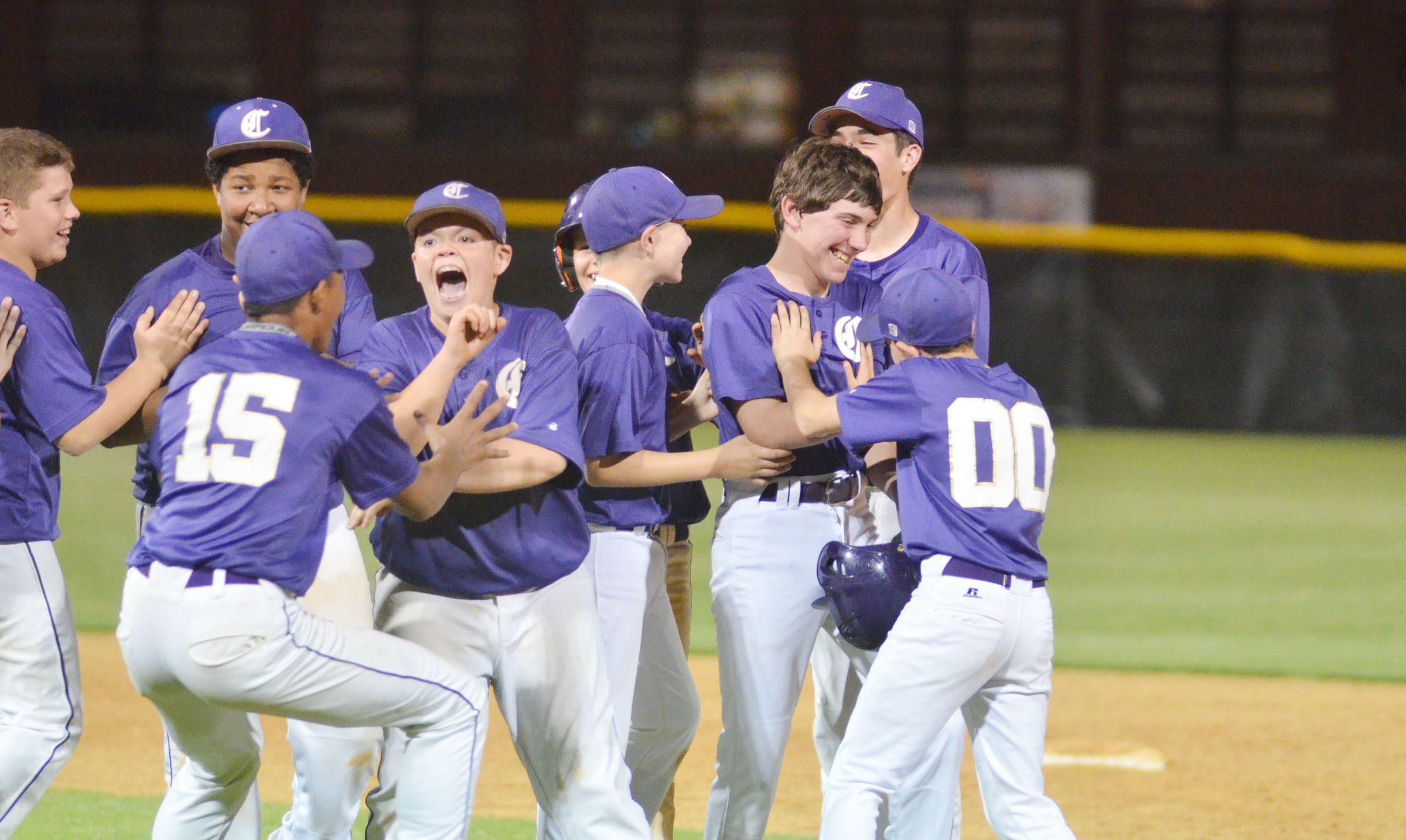 CMS seventh-grader Peyton Dabney is congratulated after getting the hit to win the game for his team.