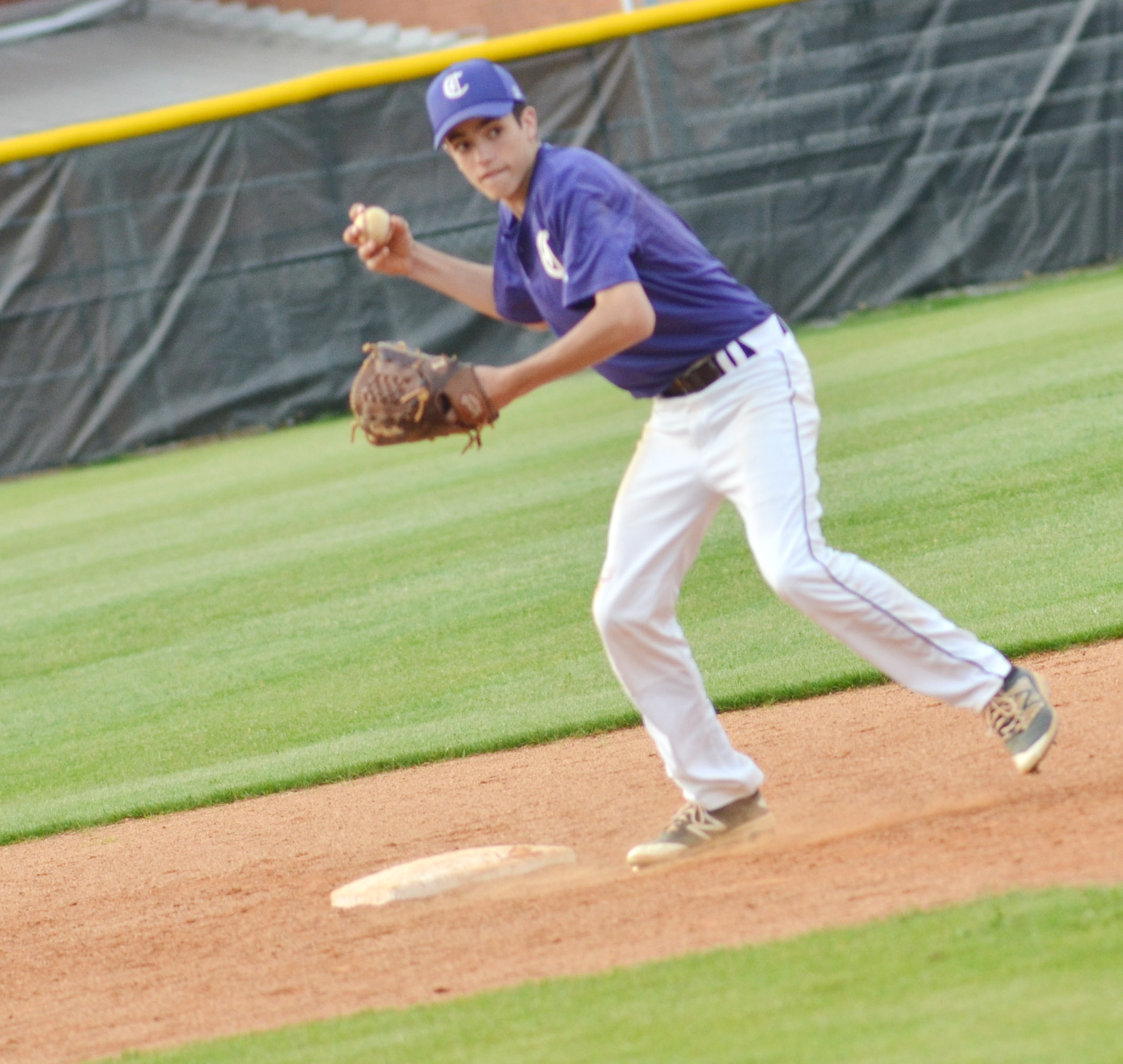 CMS eighth-grader Kameron Smith throws to first.