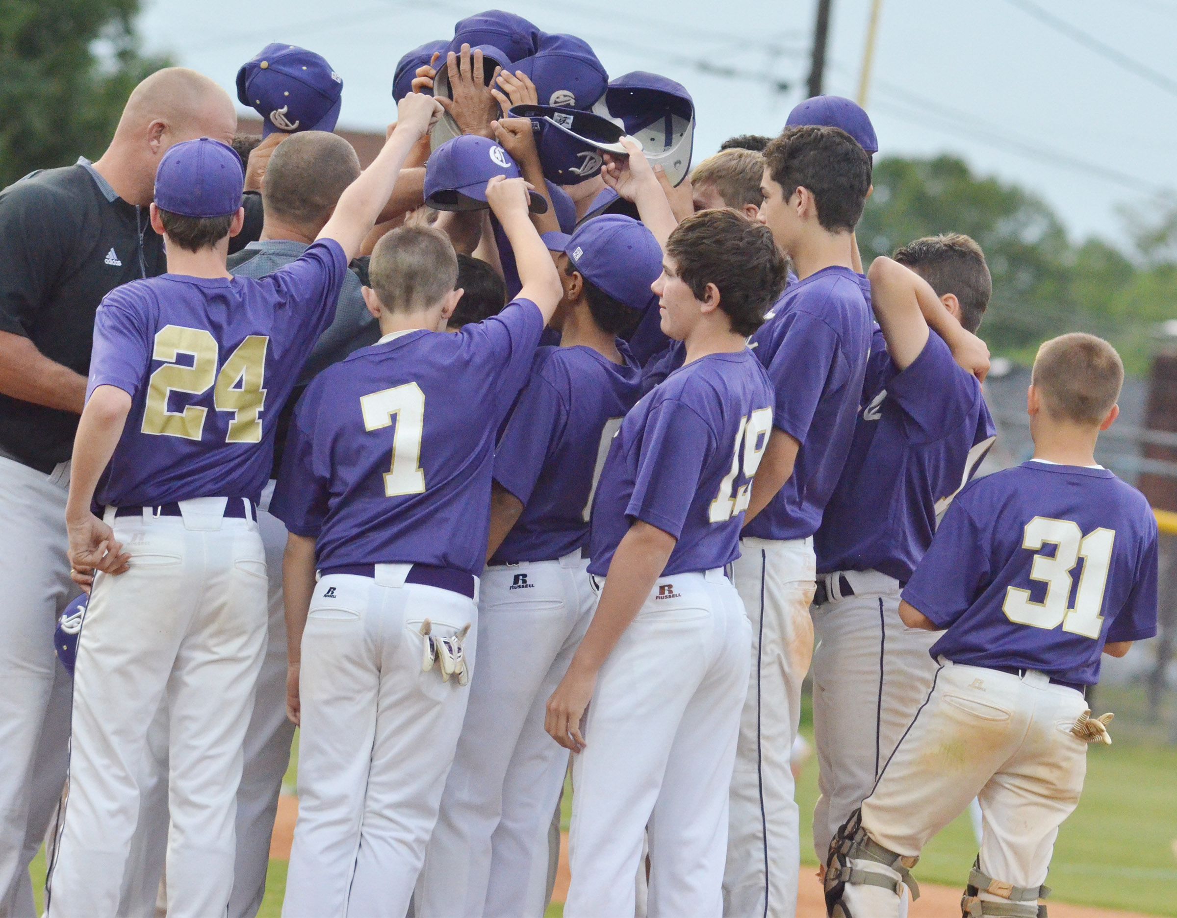 CMS baseball players huddle after their win.