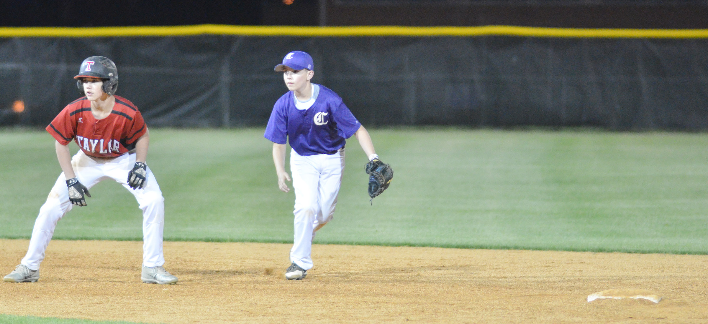CMS sixth-grader Bryce Newton keeps the runner close on second.