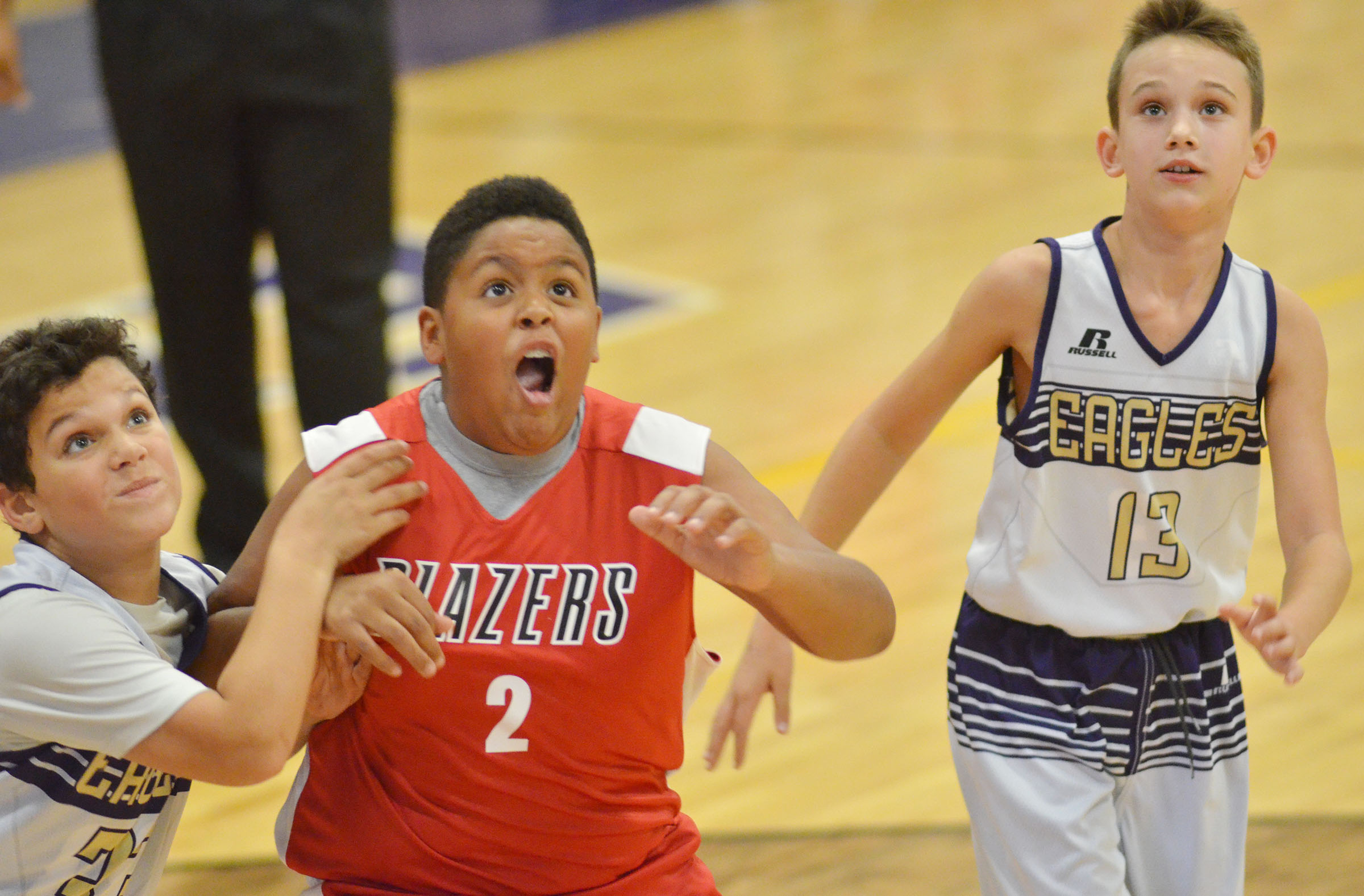 CMS sixth-graders Kaydon Taylor, at left, and Camren Vicari fight for a rebound.