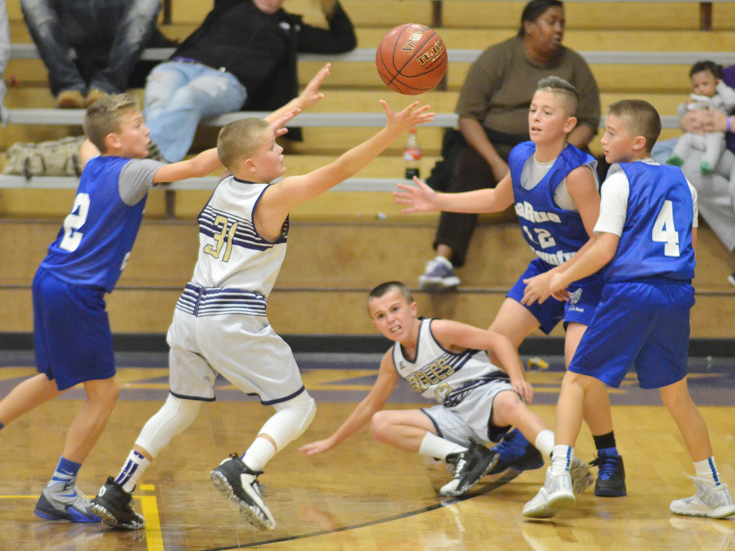 CMS sixth-grader Konner Forbis fights for the ball.