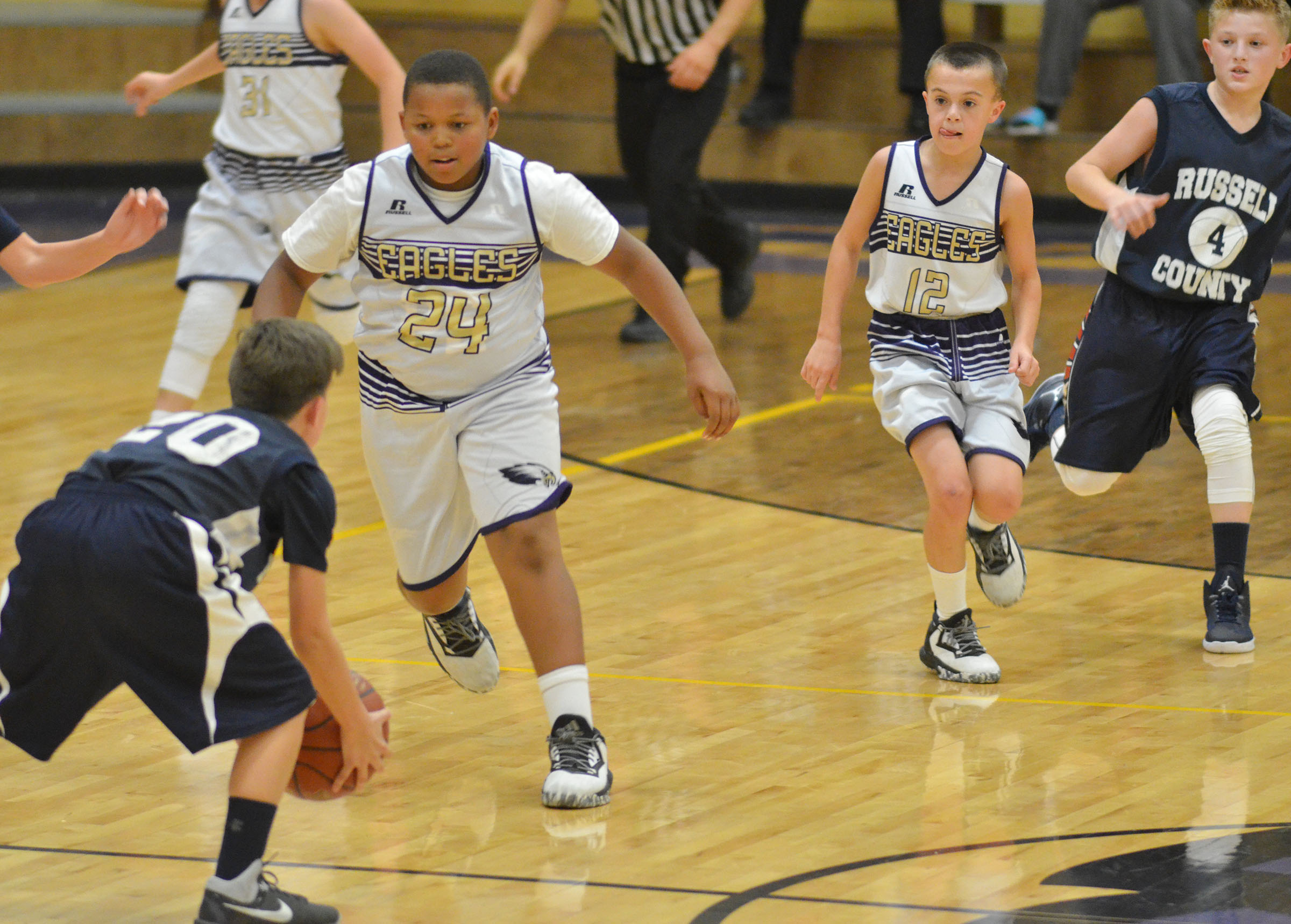 CMS sixth-graders Keondre' Weathers, at left, and Chase Hord play defense.