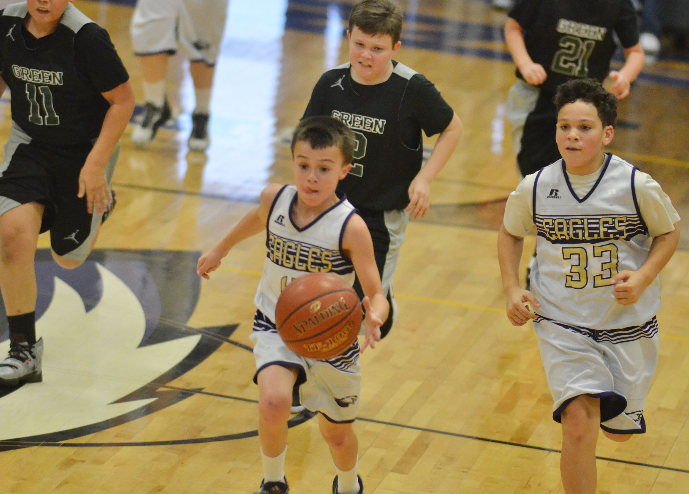 CMS sixth-graders Chase Hord, at left, and Kaydon Taylor run to the basket.