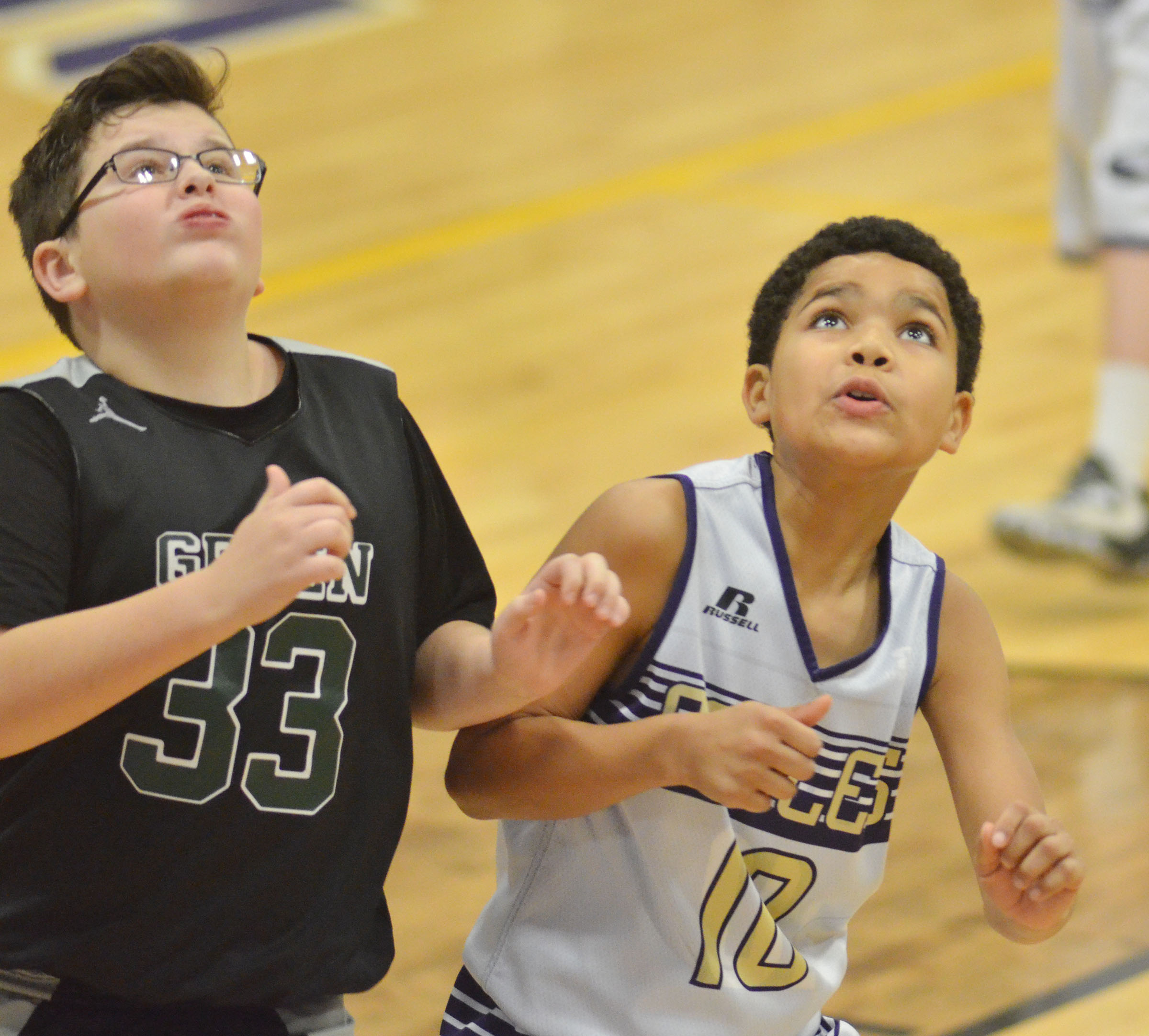 CMS sixth-grader Tashaun Hart looks for a rebound.