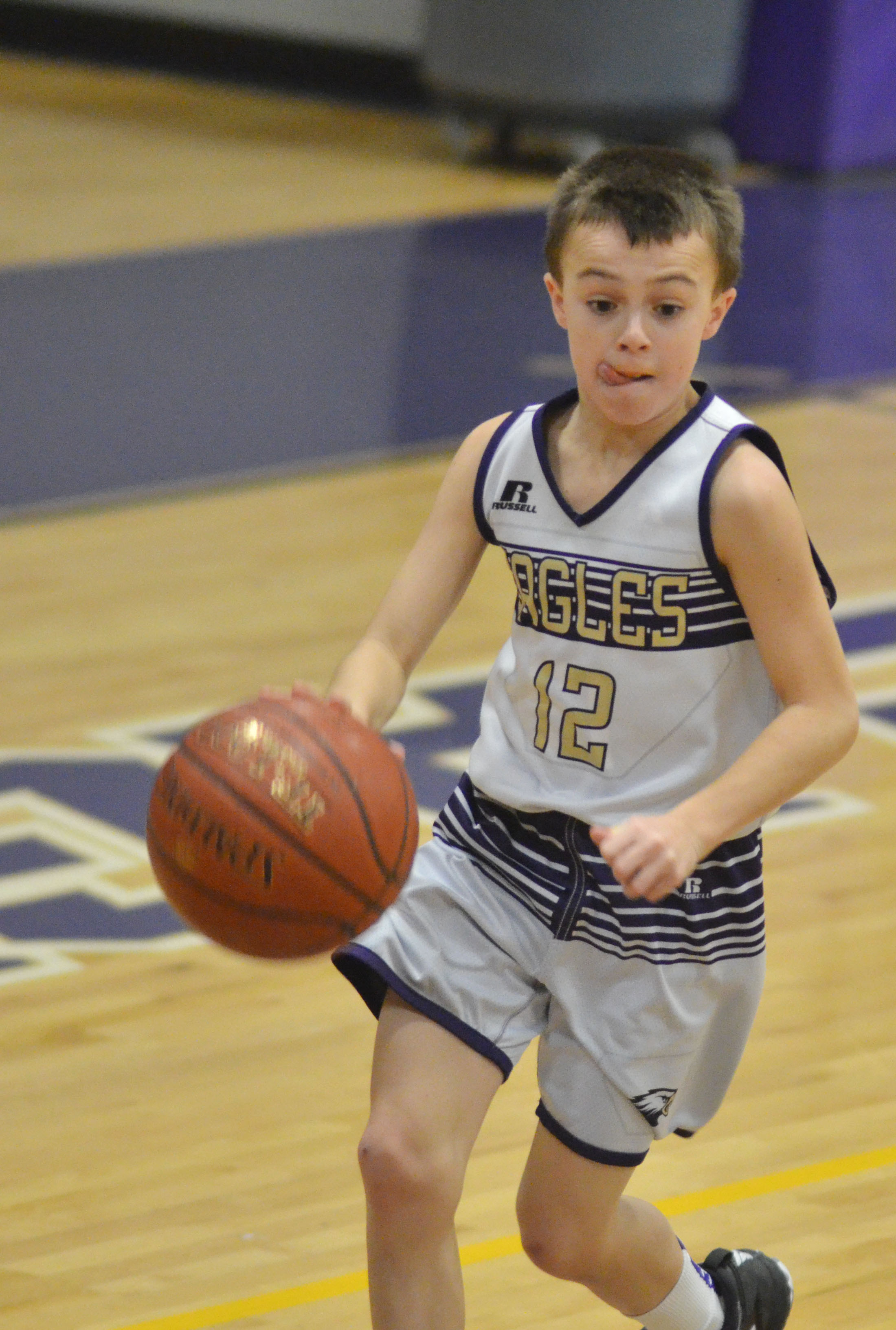 CMS sixth-grader Chase Hord runs to the basket.