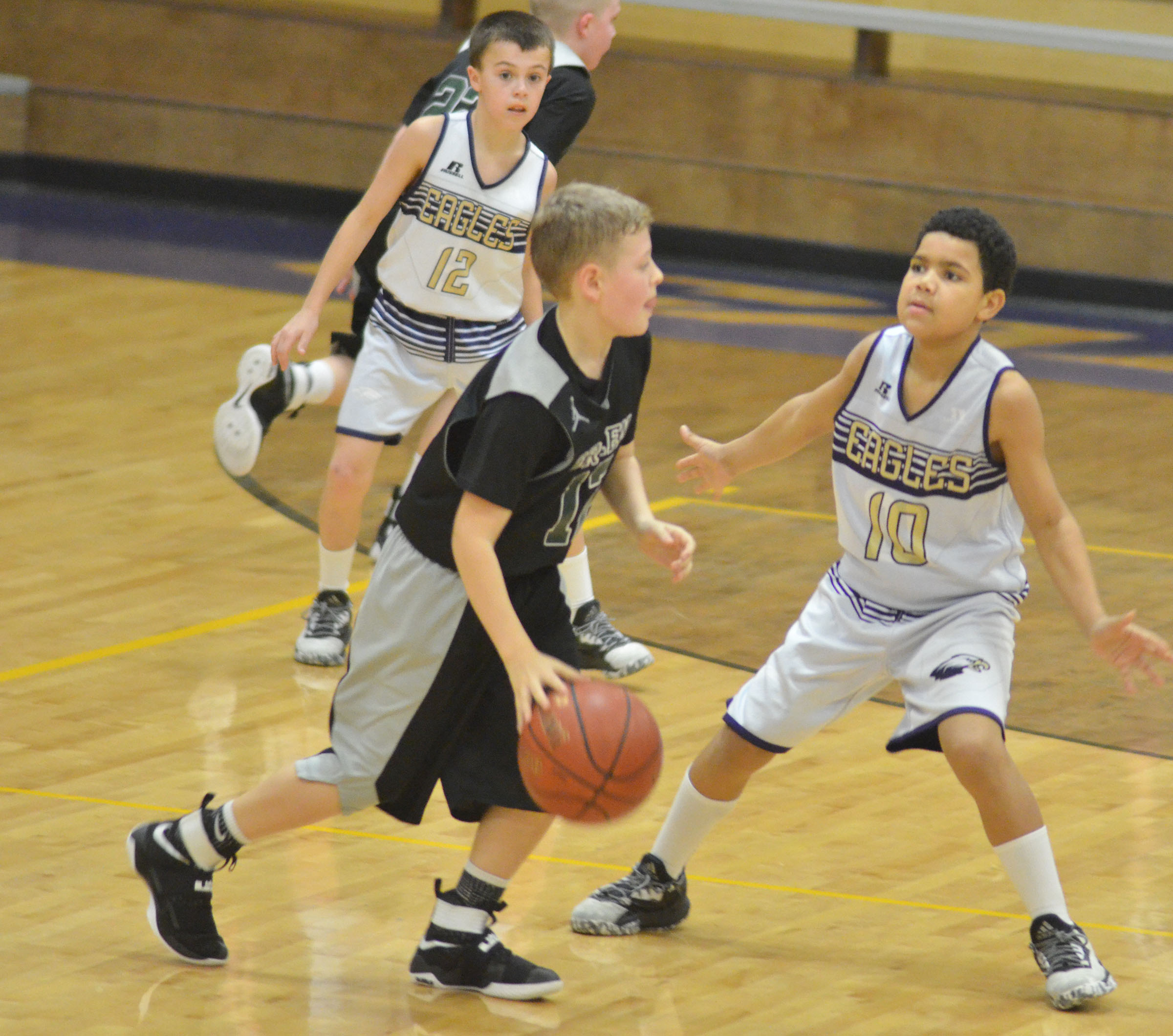 CMS sixth-grader Tashaun Hart plays defense.