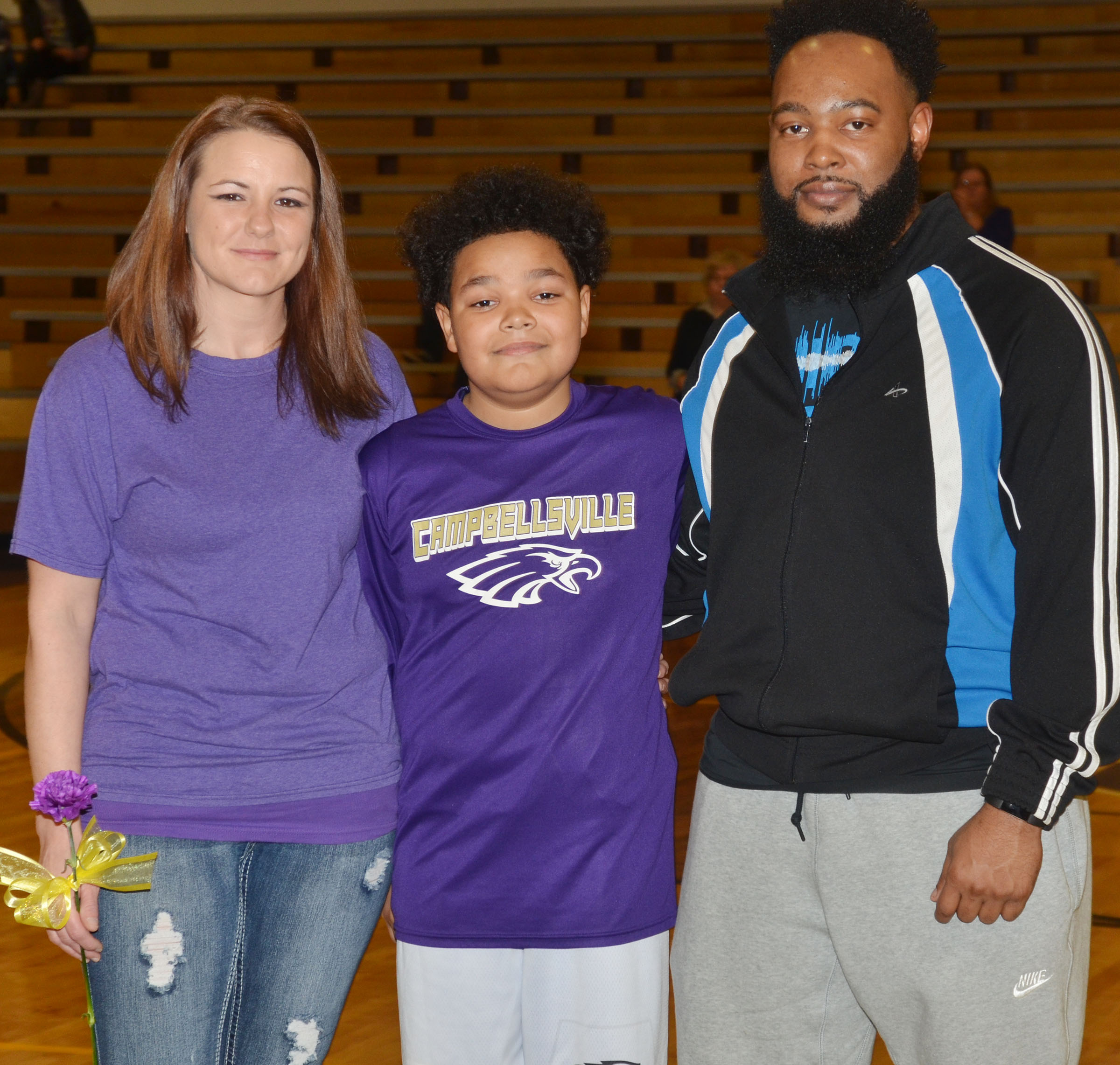 CMS eighth-grader Alex Lofton is honored. He is pictured with his parents, Ronacka and Keith.