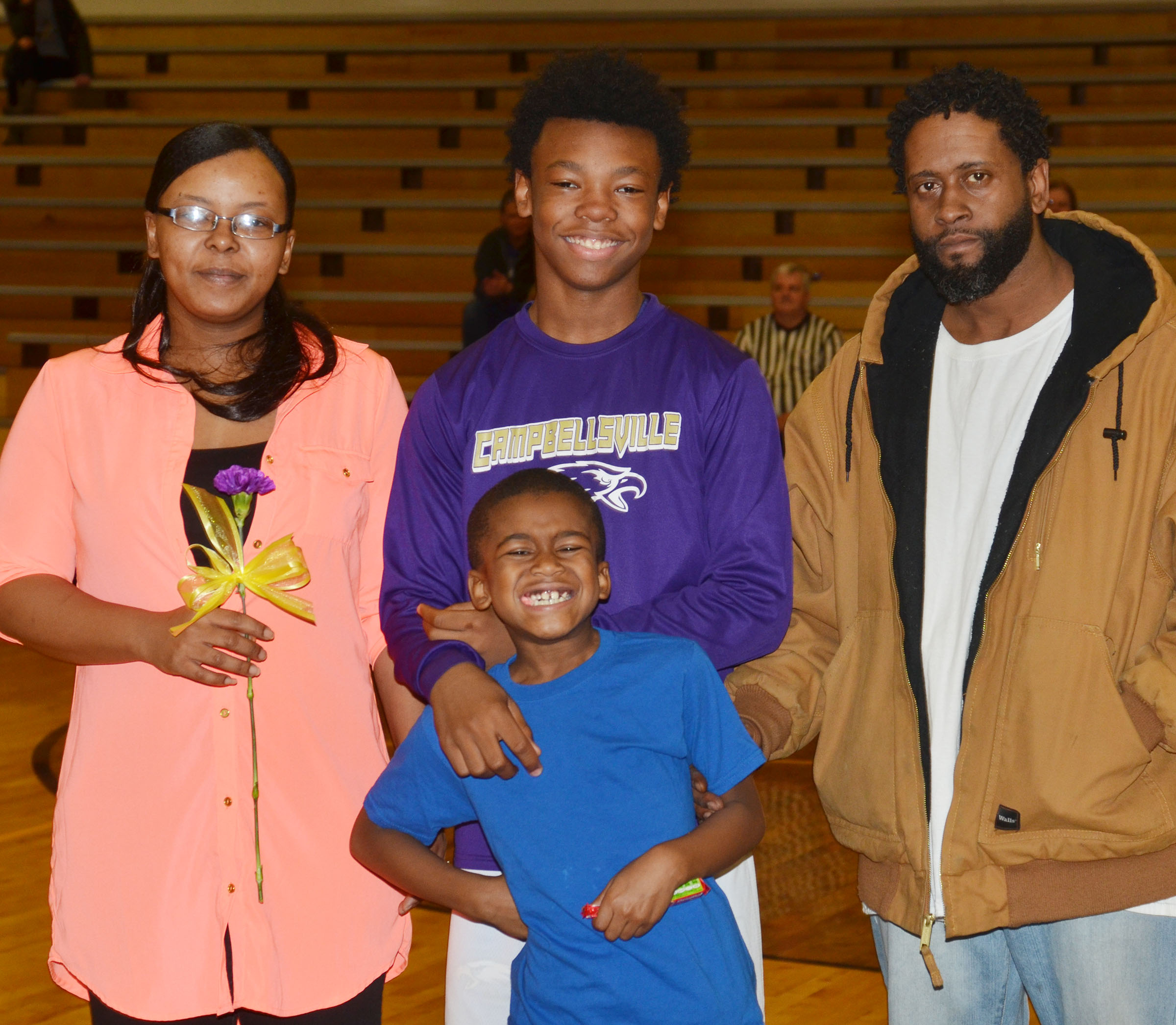 CMS eighth-grader Saevon Buckner is honored. He is pictured with his parents, Tanisha and Shawn Spaulding, and his brother, Campbellsville Elementary School second-grader Kae'vin Spaulding.