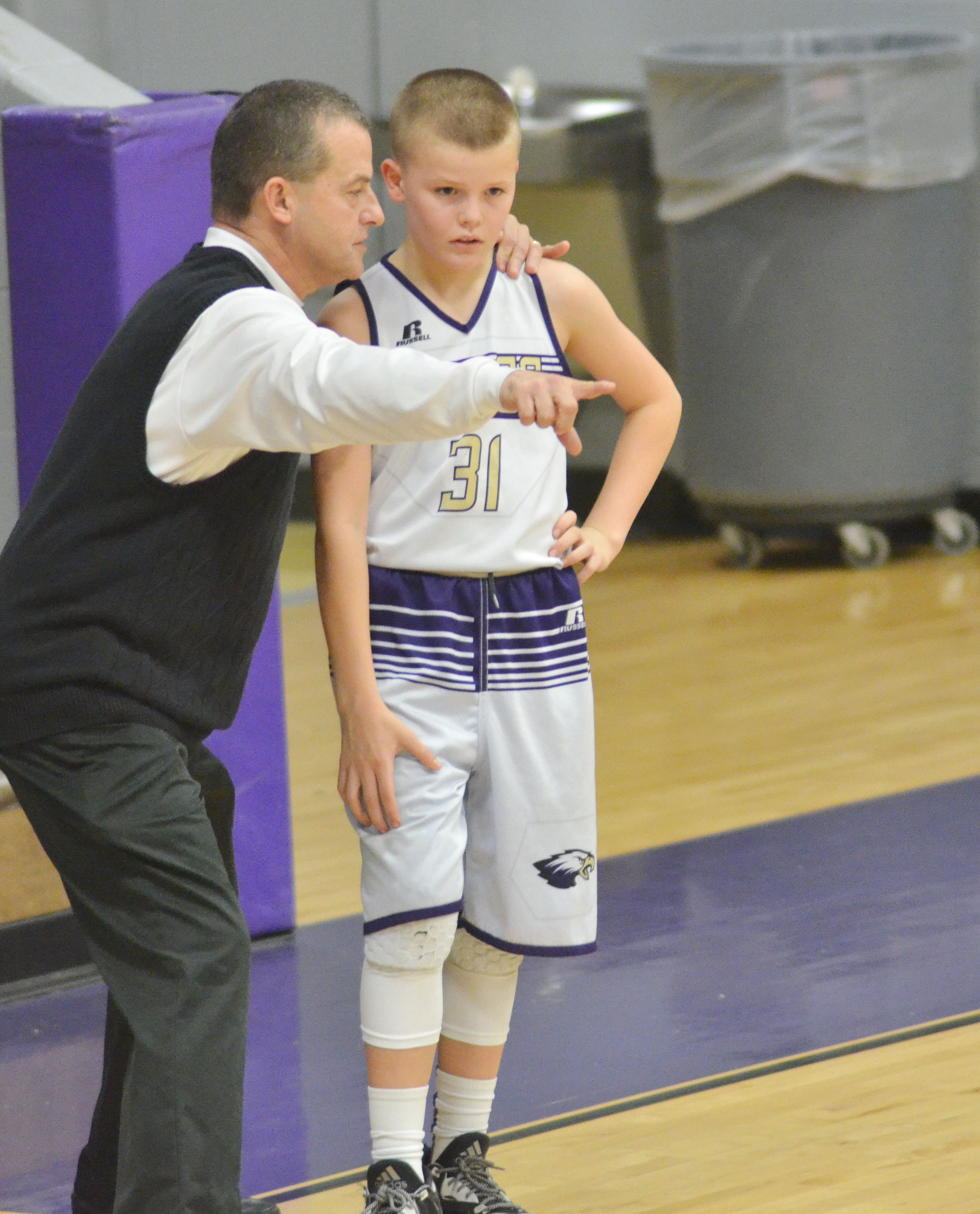 CMS sixth-grader Konner Forbis talks with coach Lynn Kearney.