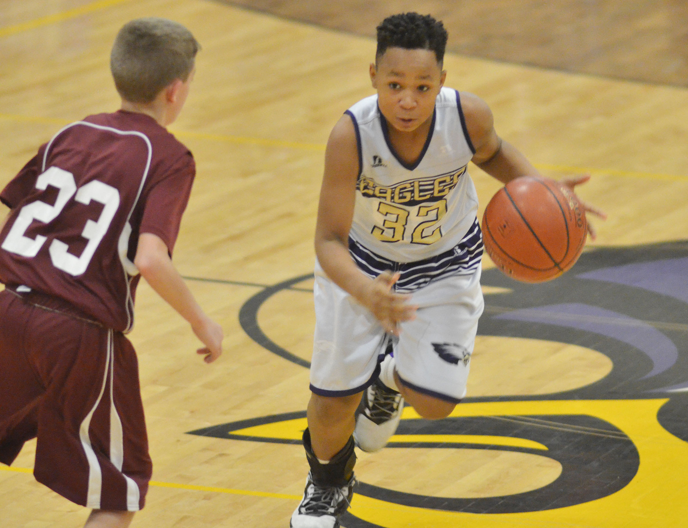 CMS sixth-grader Deondre Weathers drives the ball.