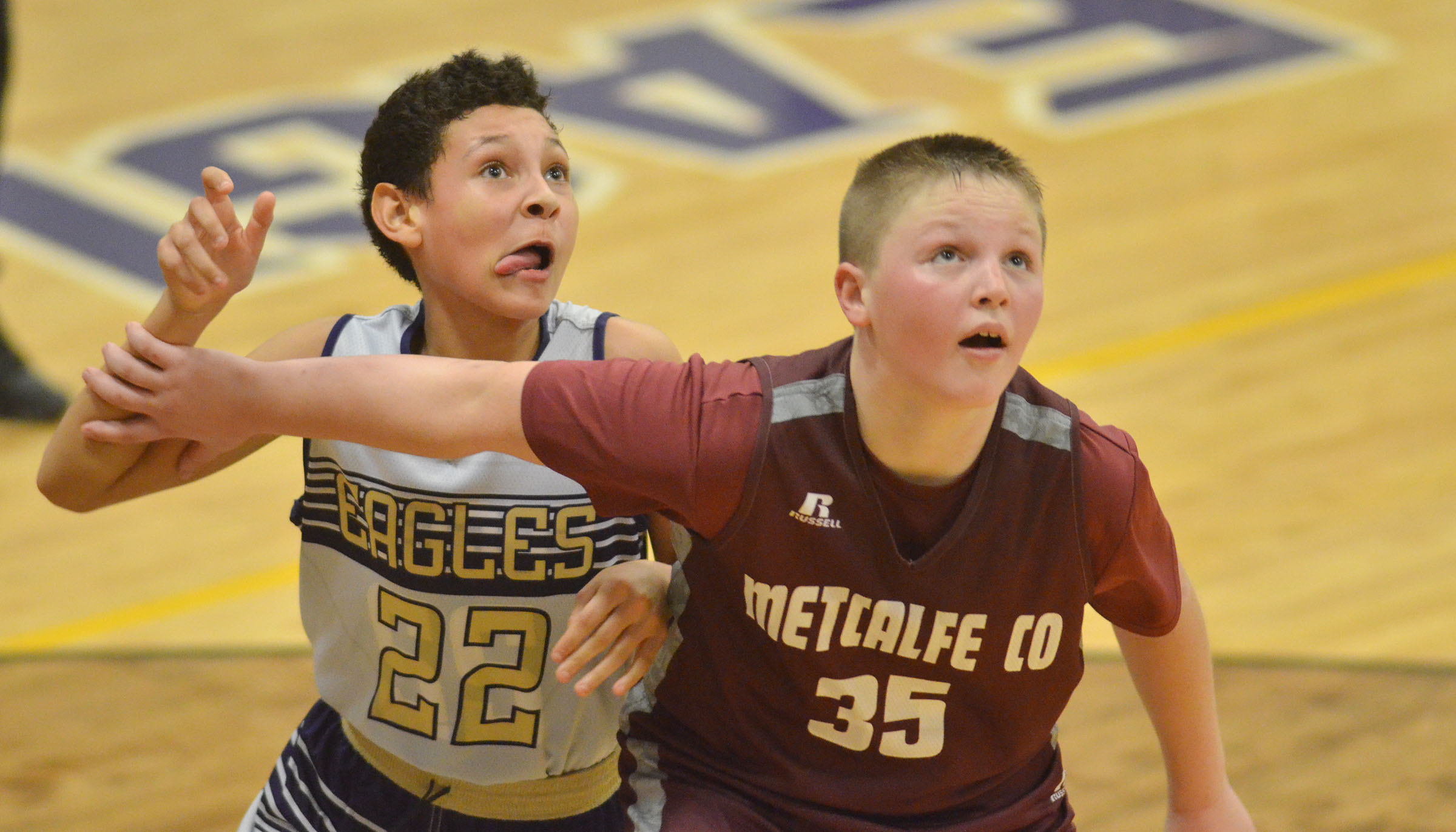 CMS seventh-grader Brice Spaw battles for a rebound.