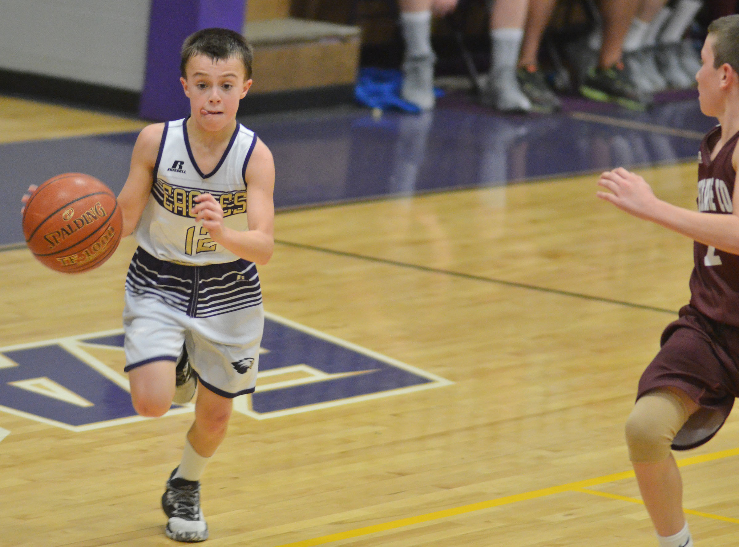CMS sixth-grader Chase Hord dribbles to the hoop.