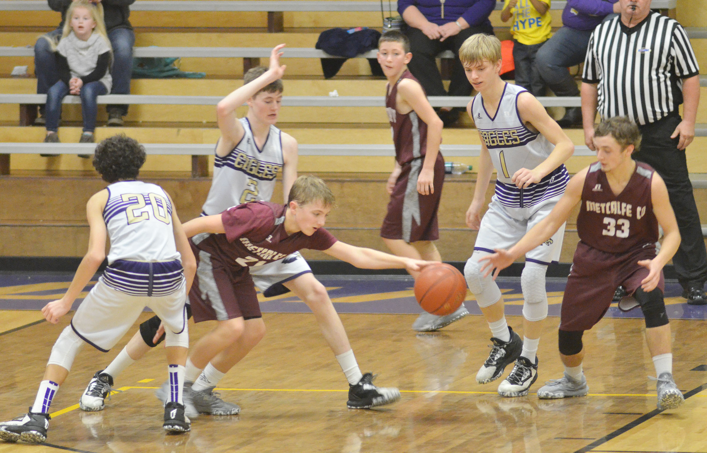 CMS eighth-graders, from left, Kameron Smith, Tristin Faulkner and Arren Hash play defense.