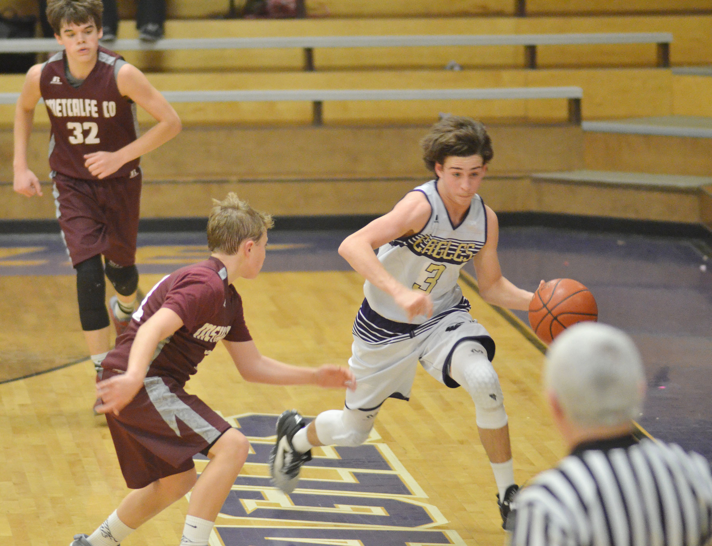 CMS eighth-grader John Orberson dribbles around a Metcalfe County defender.