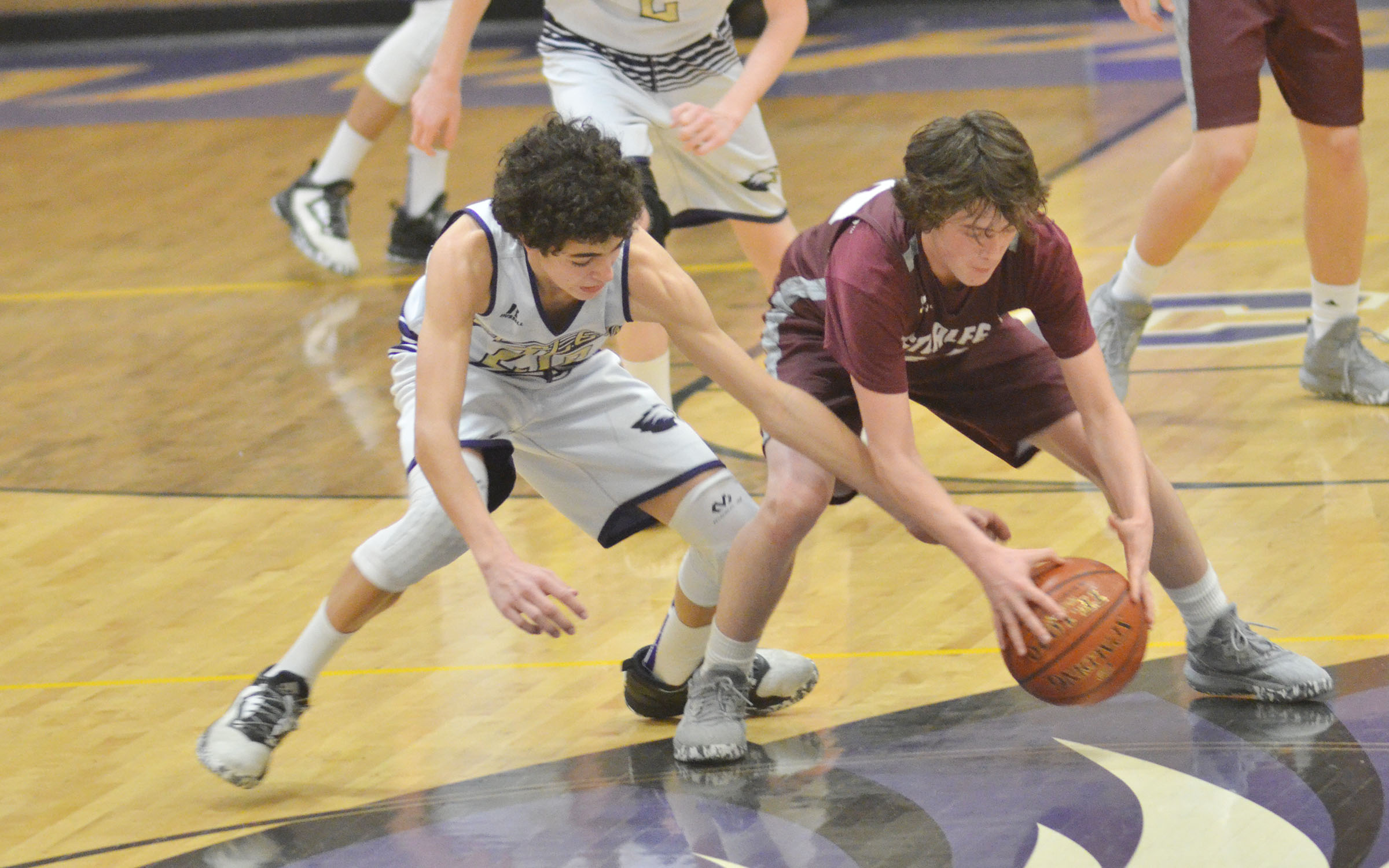 CMS eighth-grader Kameron Smith battles for the ball.