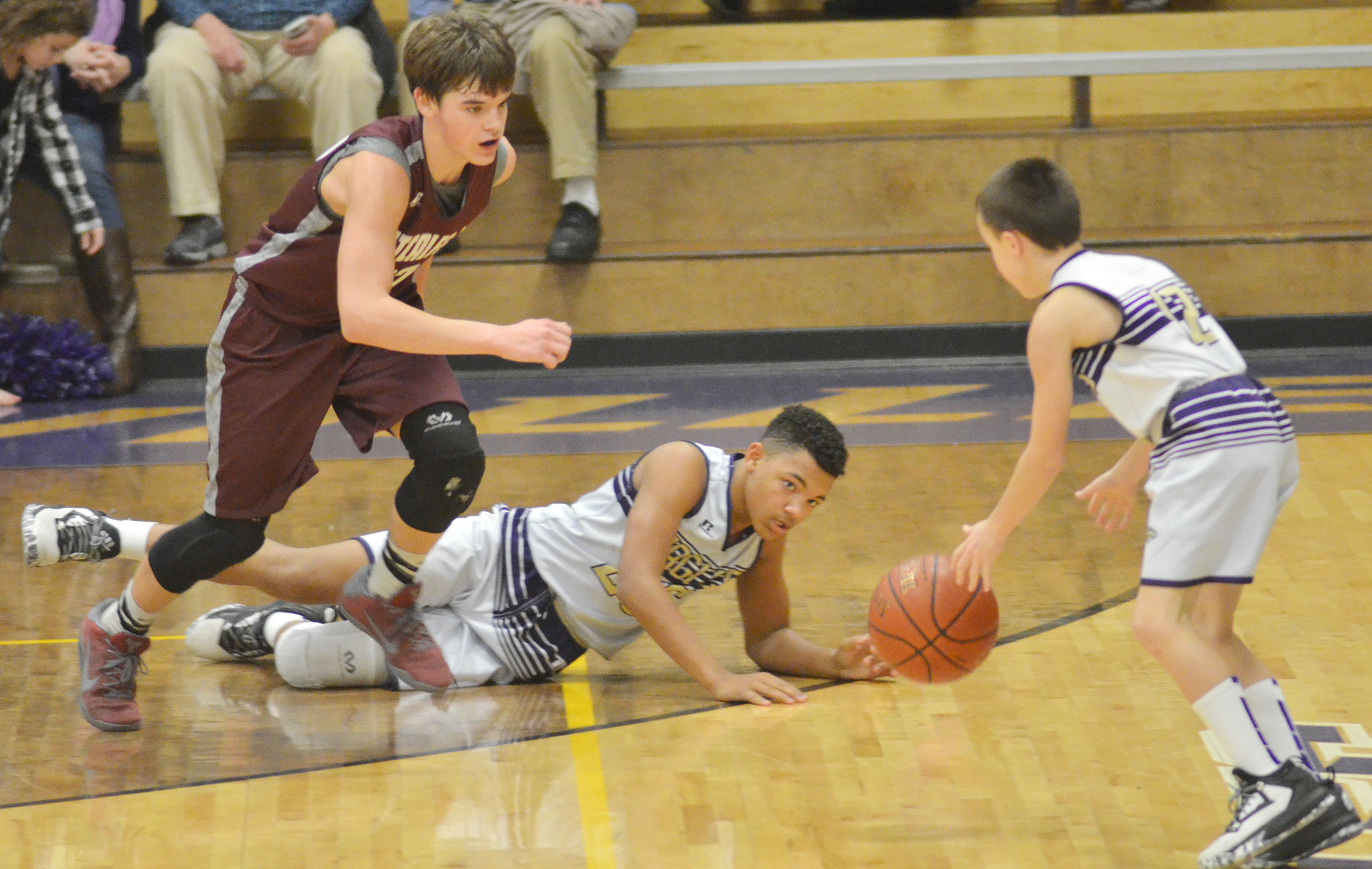 CMS eighth-grader Reggie Thomas passes the ball to sixth-grader Chase Hord.