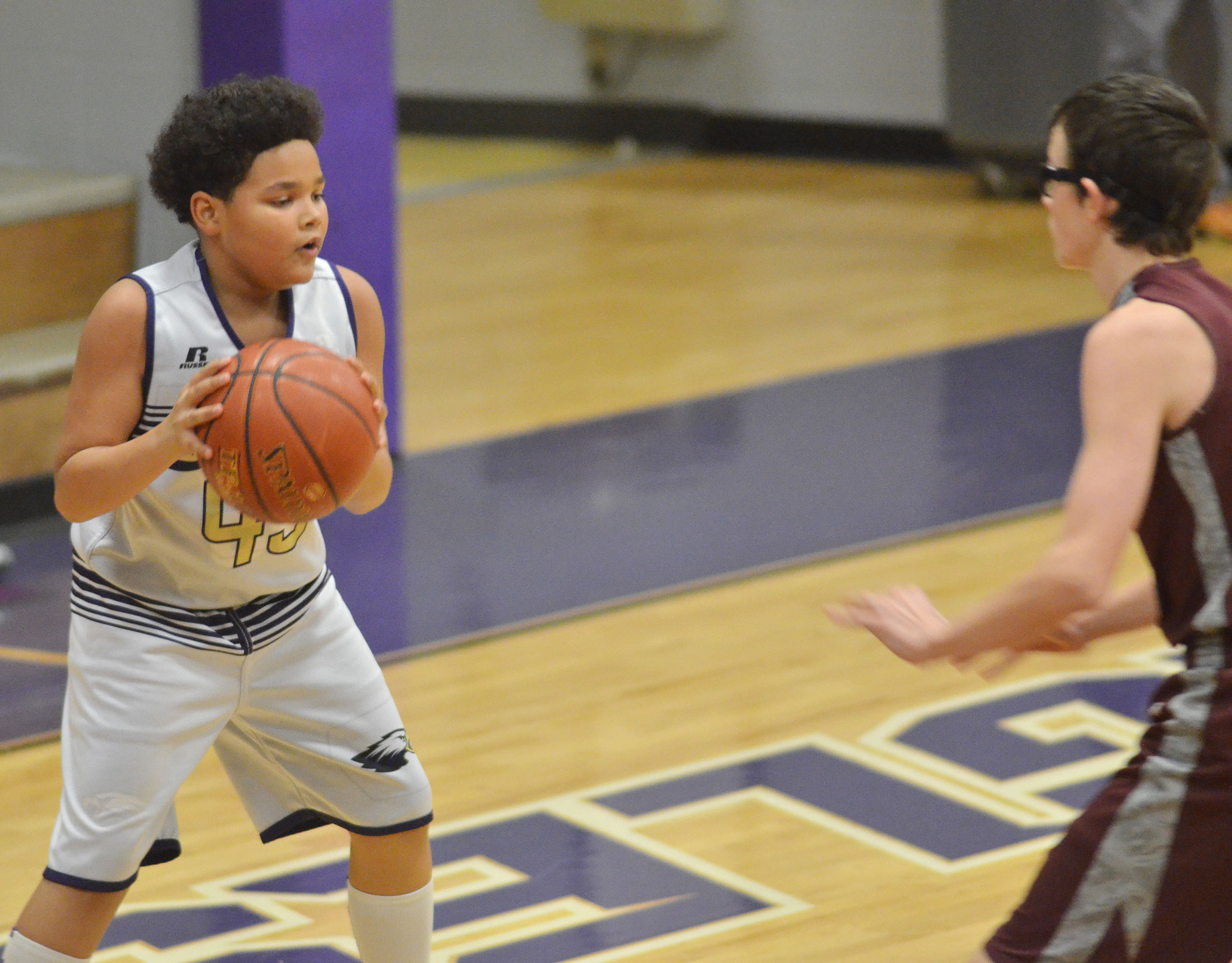 CMS eighth-grader Alex Lofton passes.