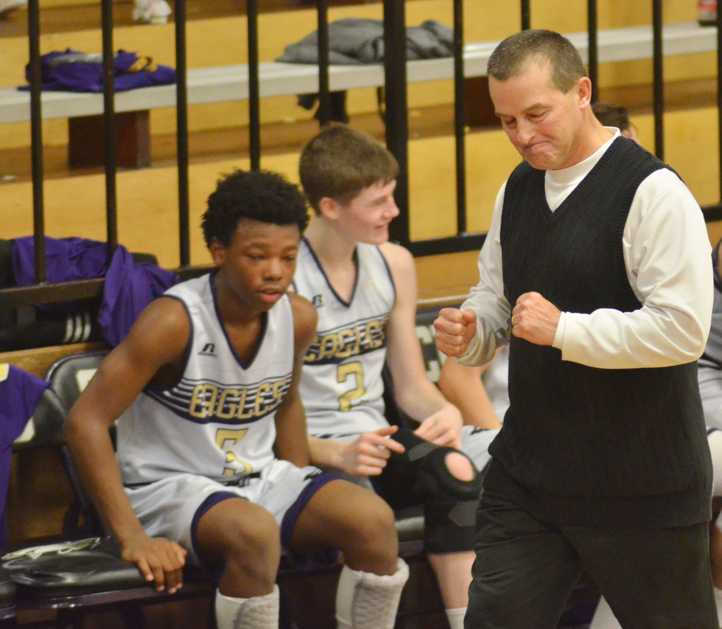 CMS boys' basketball coach Lynn Kearney reacts as his team wins its final game of the regular season and finishes as undefeated.