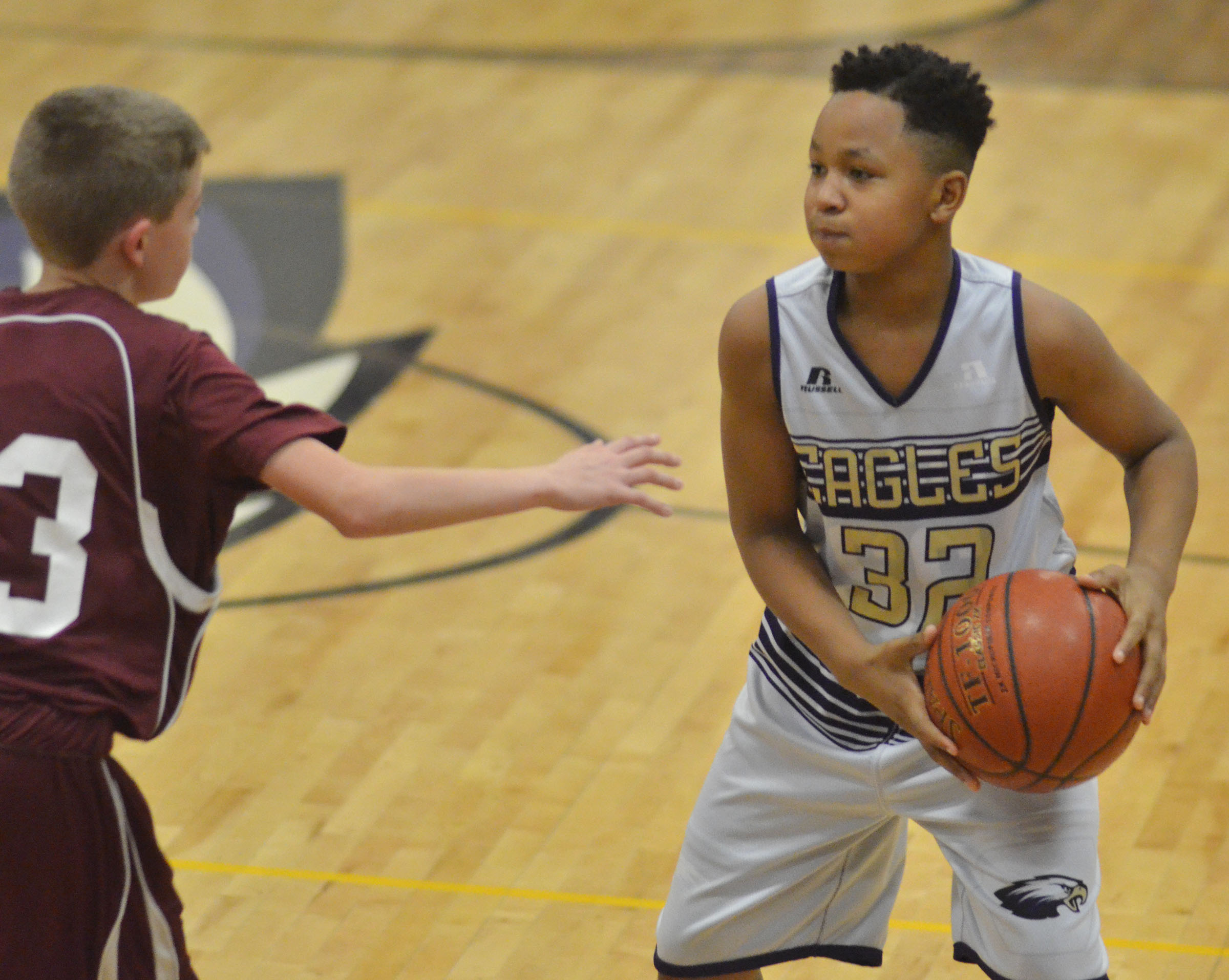 CMS sixth-grader Deondre Weathers protects the ball.