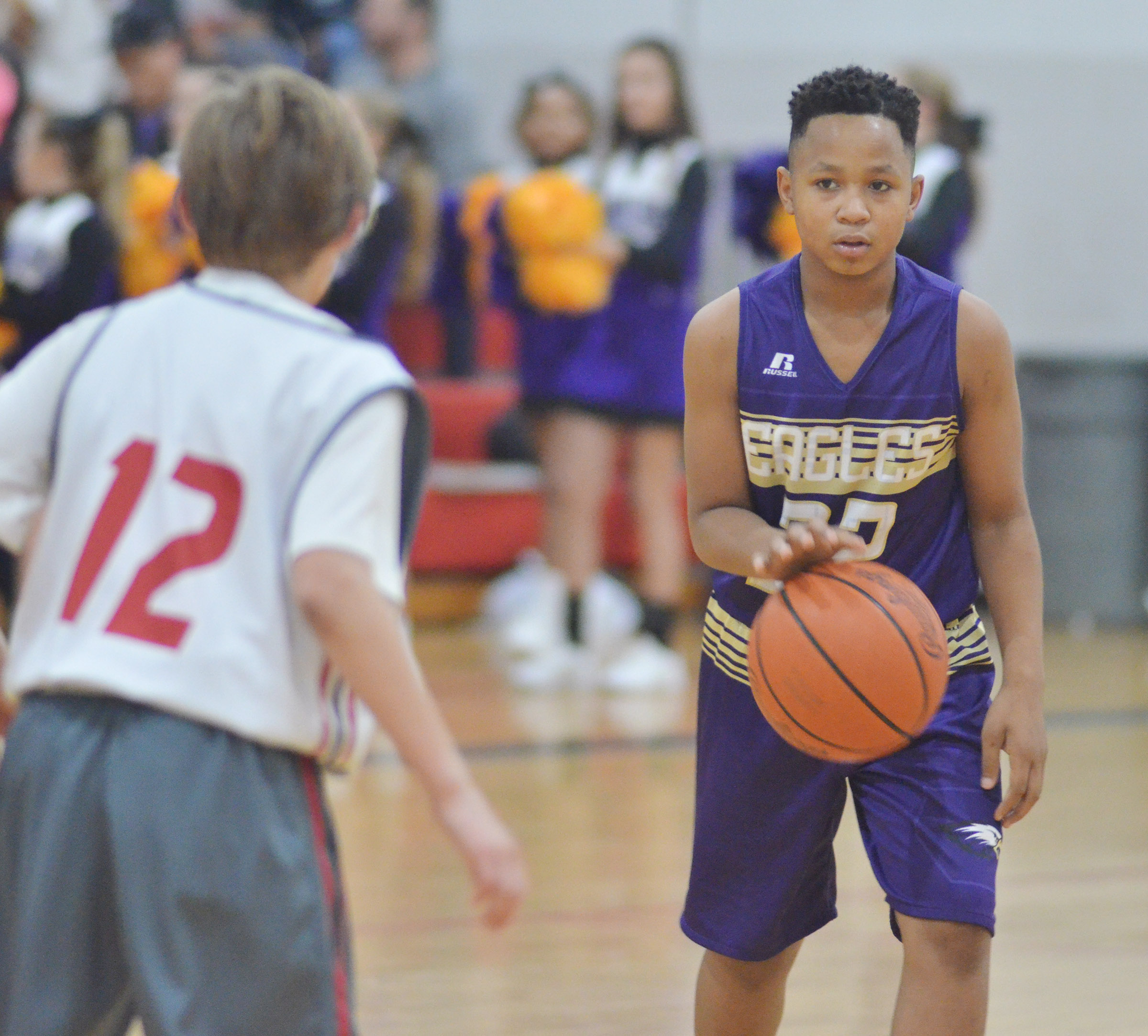 CMS sixth-grader Deondre Weathers dribbles.