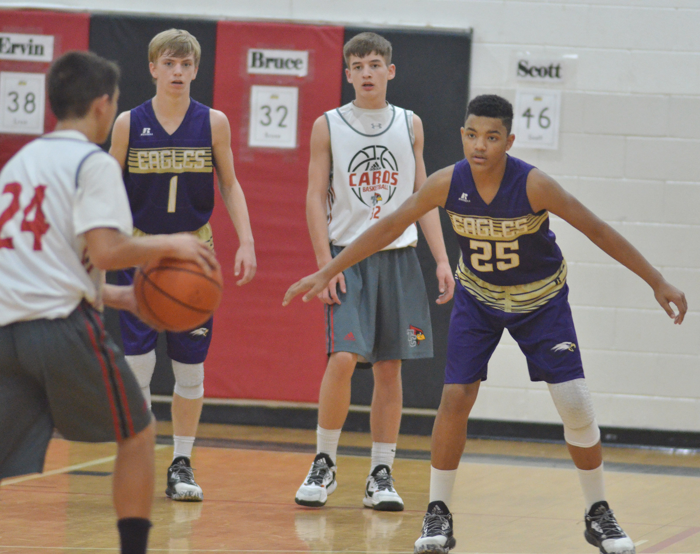 CMS eighth-graders Arren Hash, at left, and Reggie Thomas play defense.
