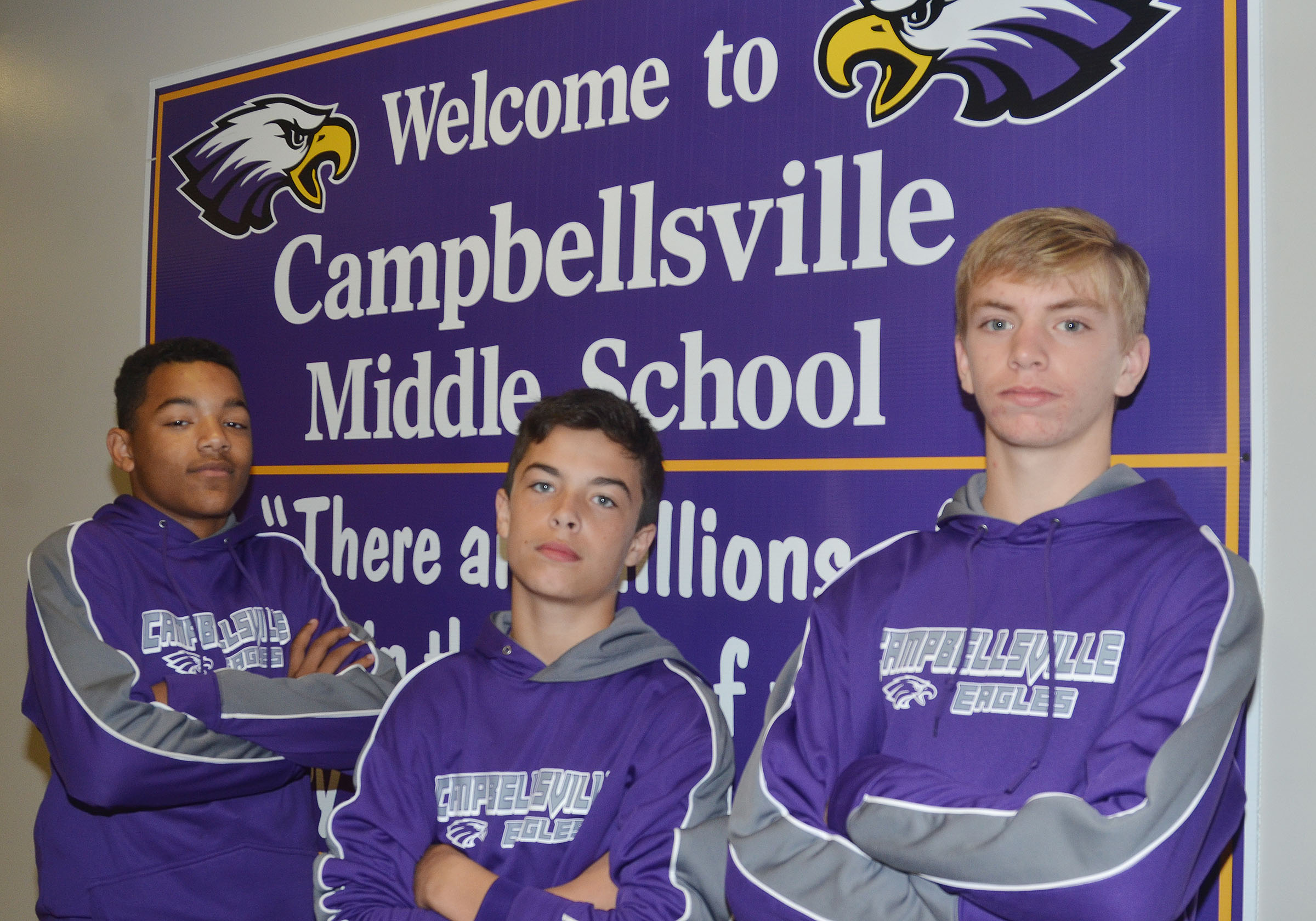 CMS eighth-grader Reggie Thomas, at left, was named to the Kentucky Middle School Football Association west all-star team, and sixth-grader Gavin Oliver, center, and eighth-grader Arren Hash were named to Football University's national Team Kentucky.