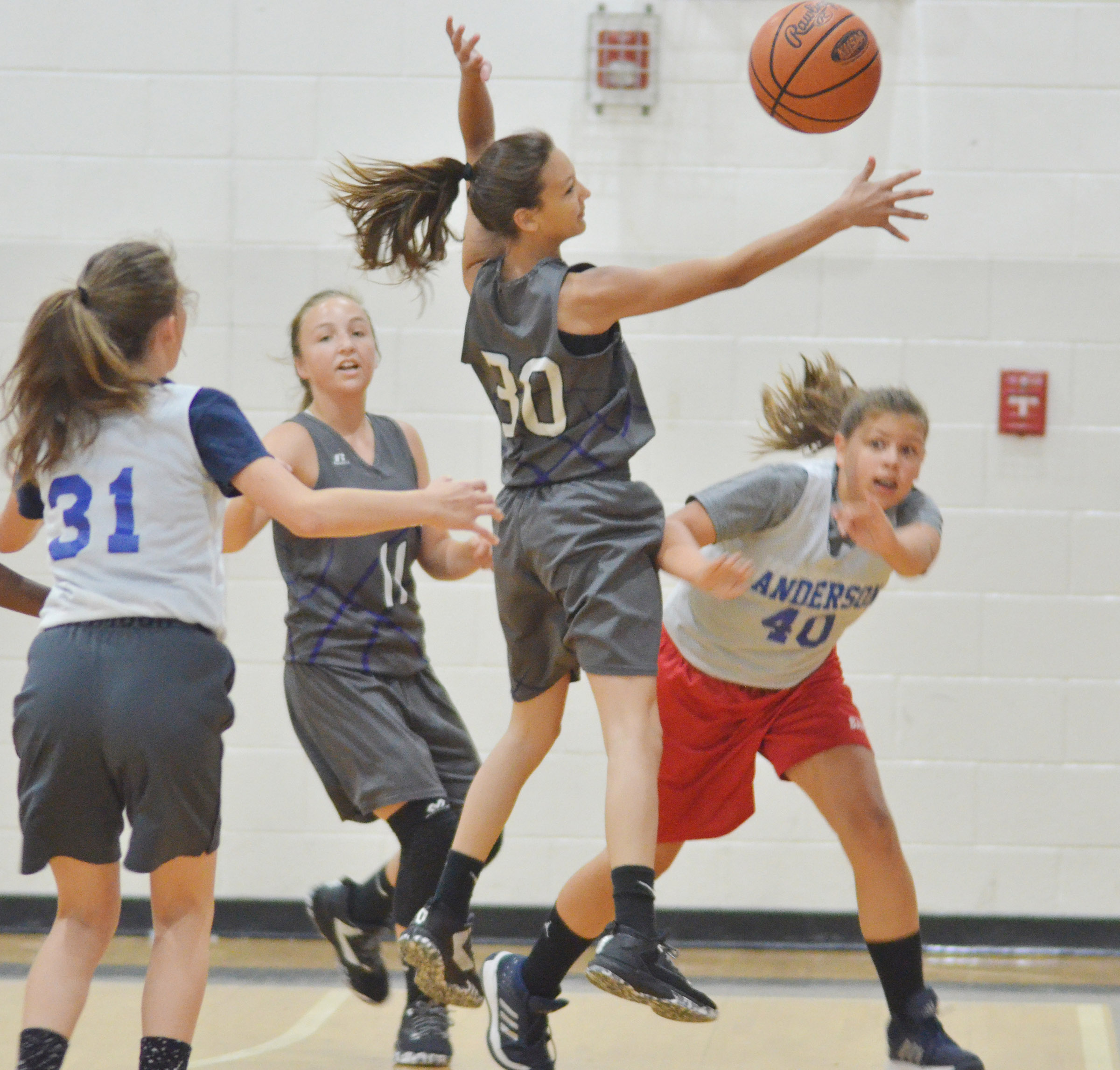 CMS seventh-grader Bri Hayes jumps for the ball.