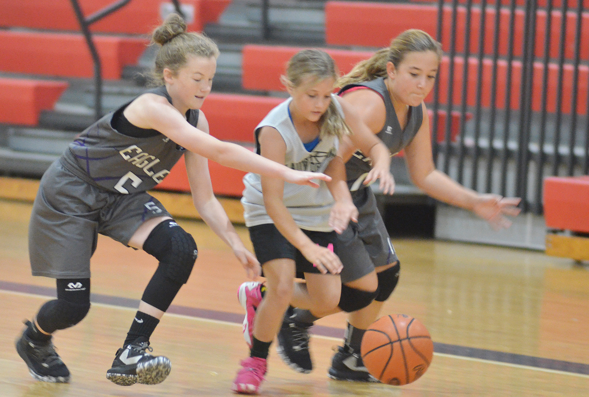 CMS seventh-graders Dakota Slone, at left, and Briana Davis try to steal the ball.