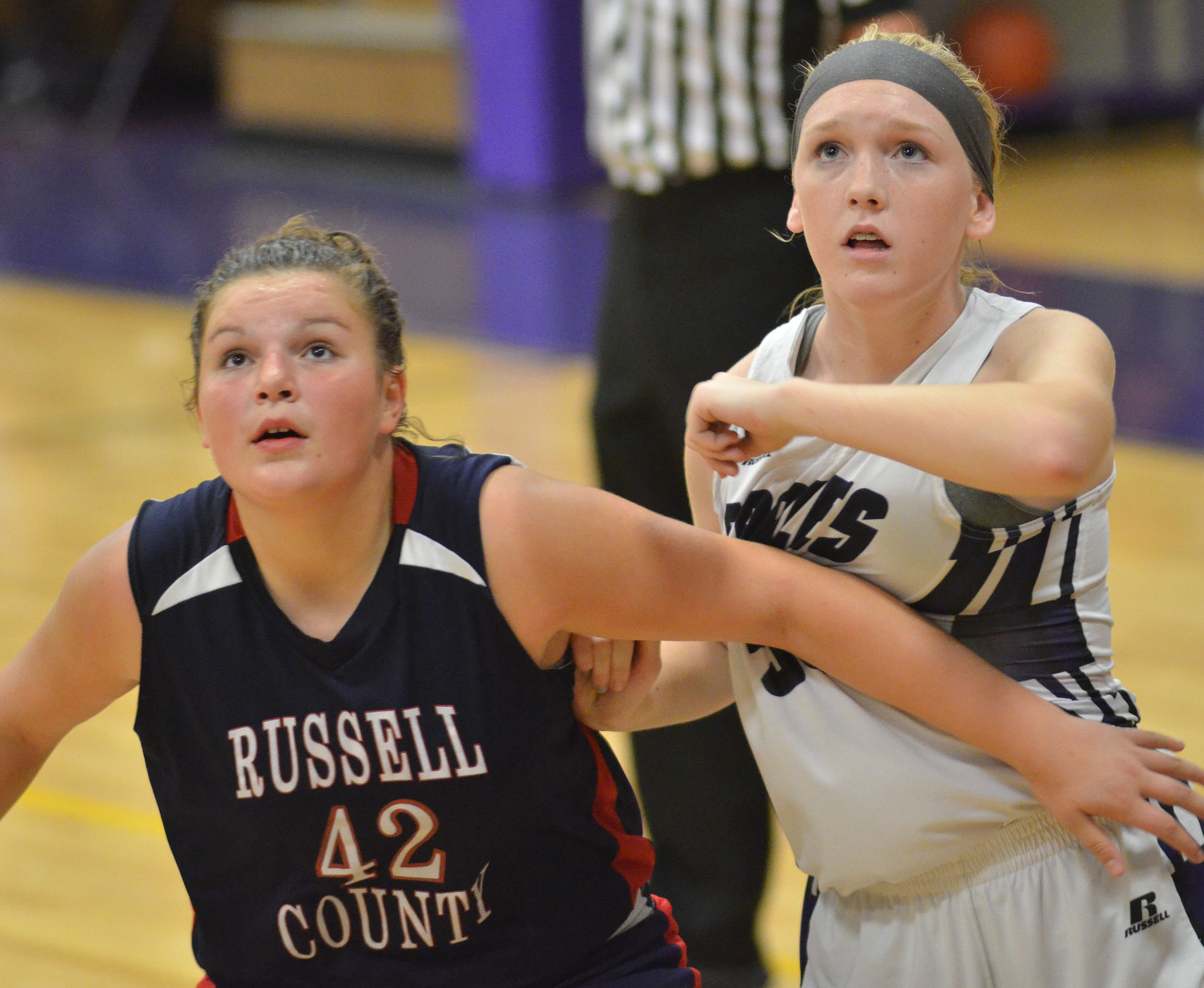 CMS eighth-grader Catlyn Clausen looks for a rebound.