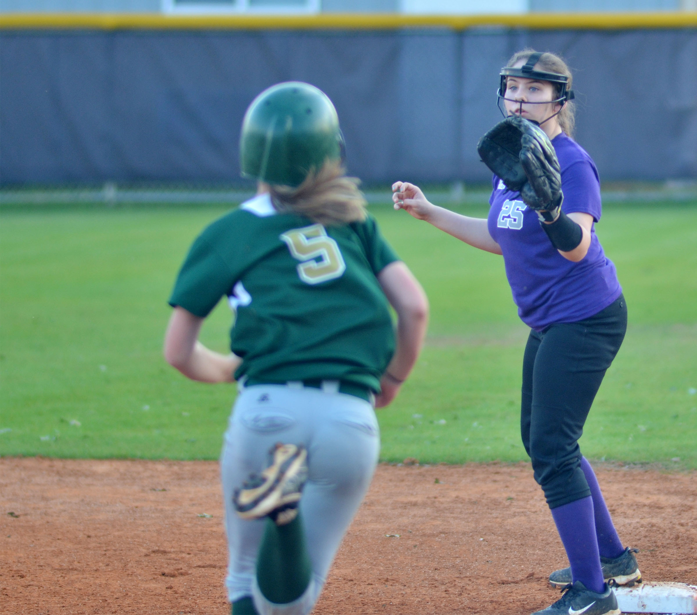 CMS eighth-grader Kaylee Reynolds gets an out at first.