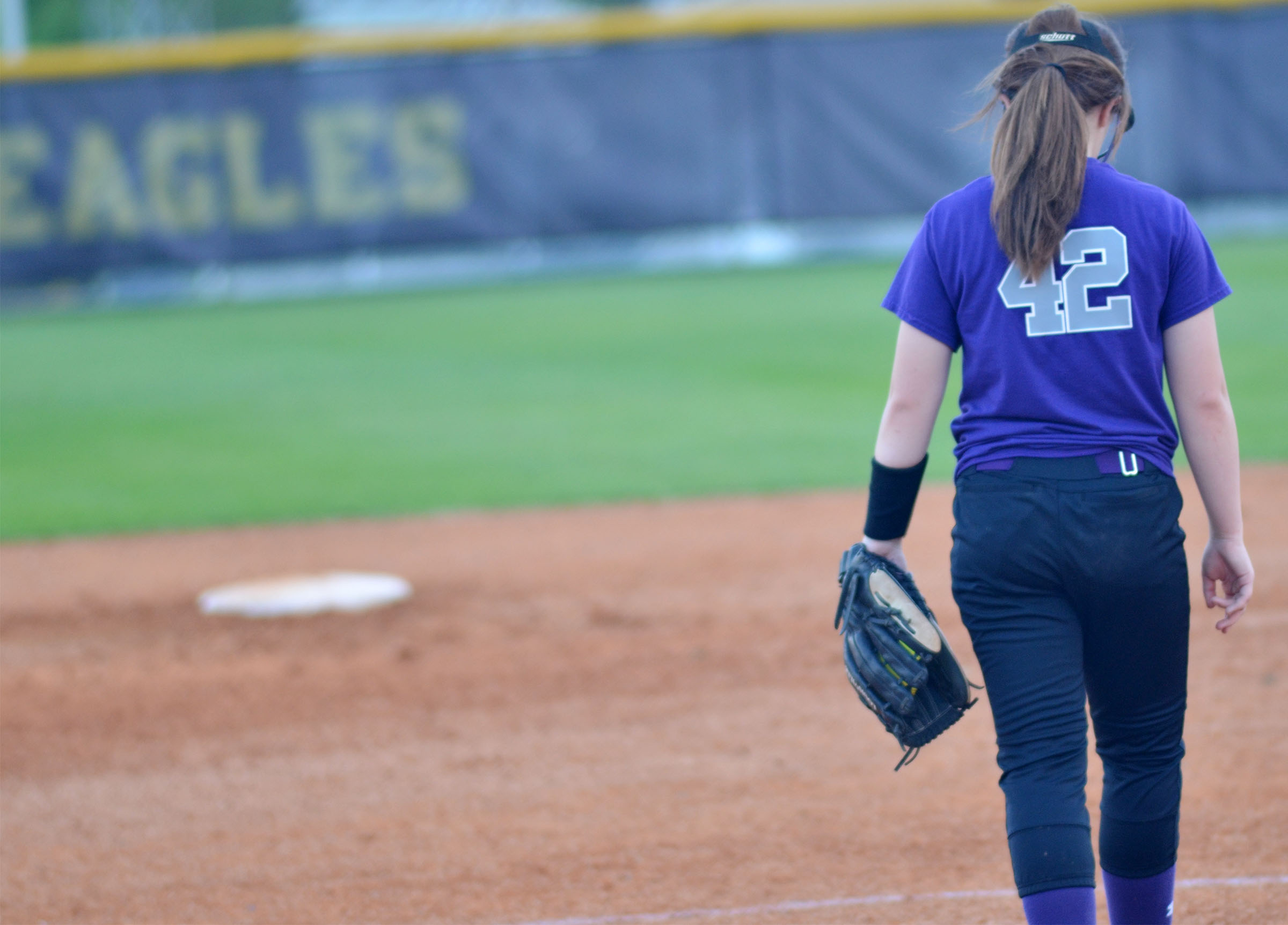 CMS seventh-grader Olivia Fields walks to the pitcher's mound.