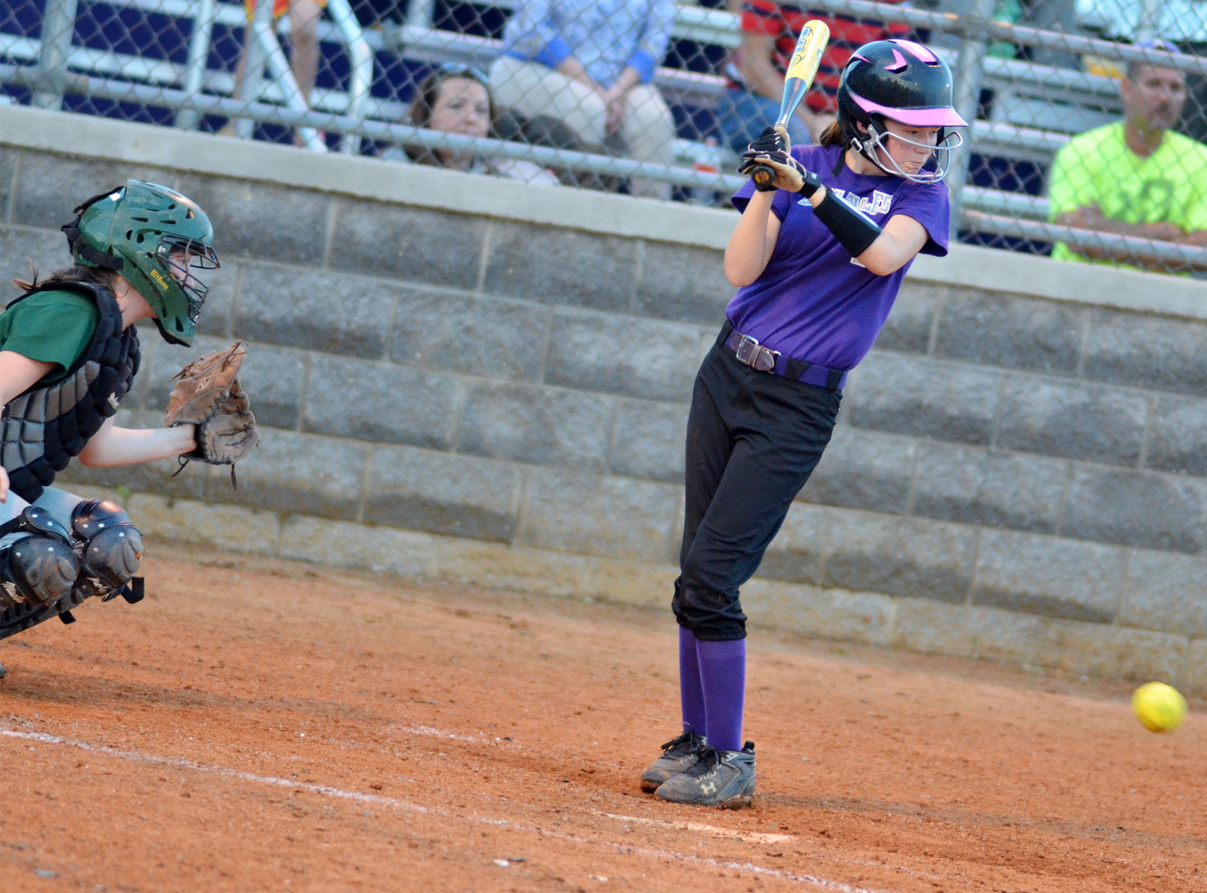CMS sixth-grader BreAnna Humphress braces herself as the ball comes to the plate.