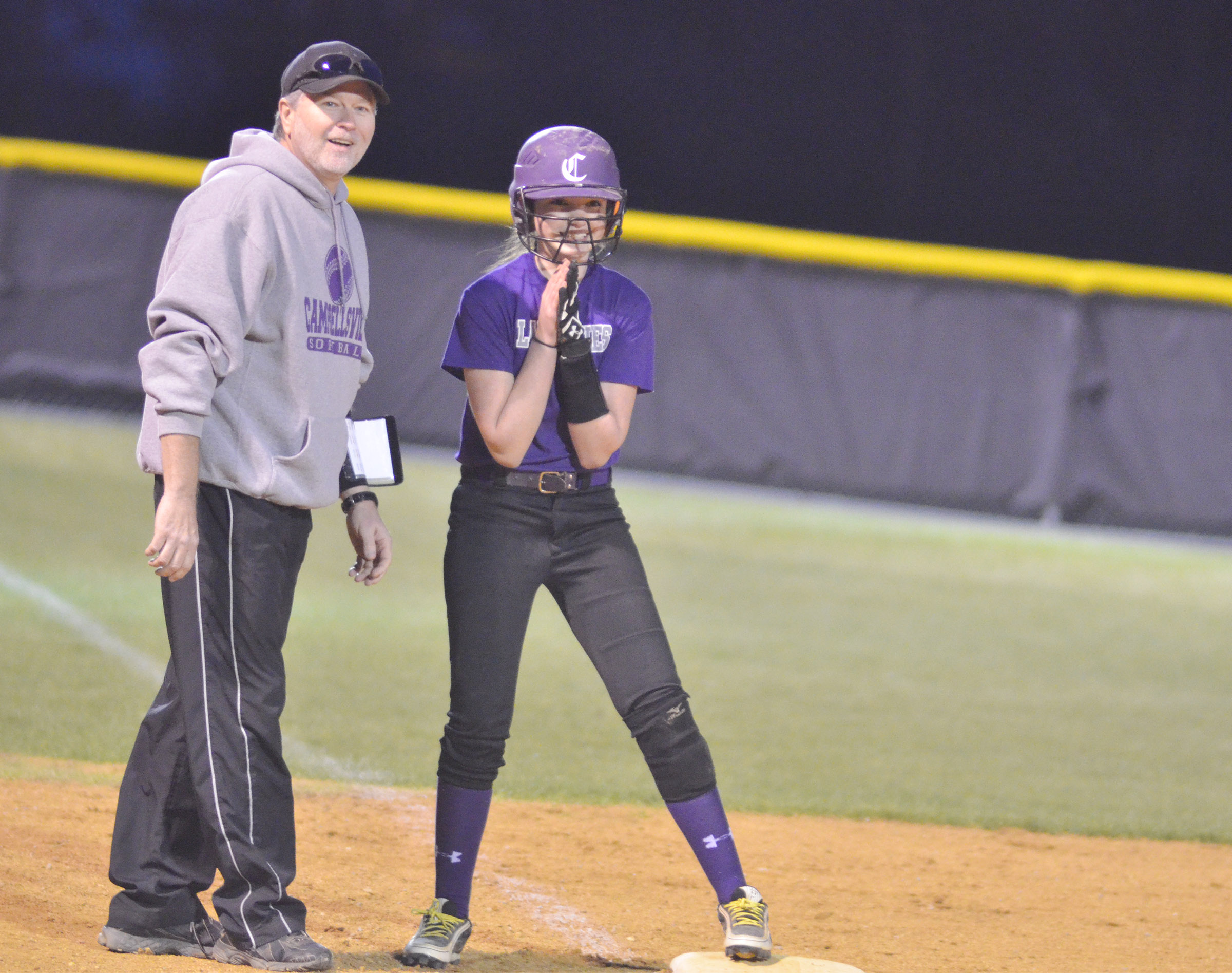 CMS seventh-grader Karley Morris smiles as she gets set to score. At left is assistant coach Bobby Hayes.