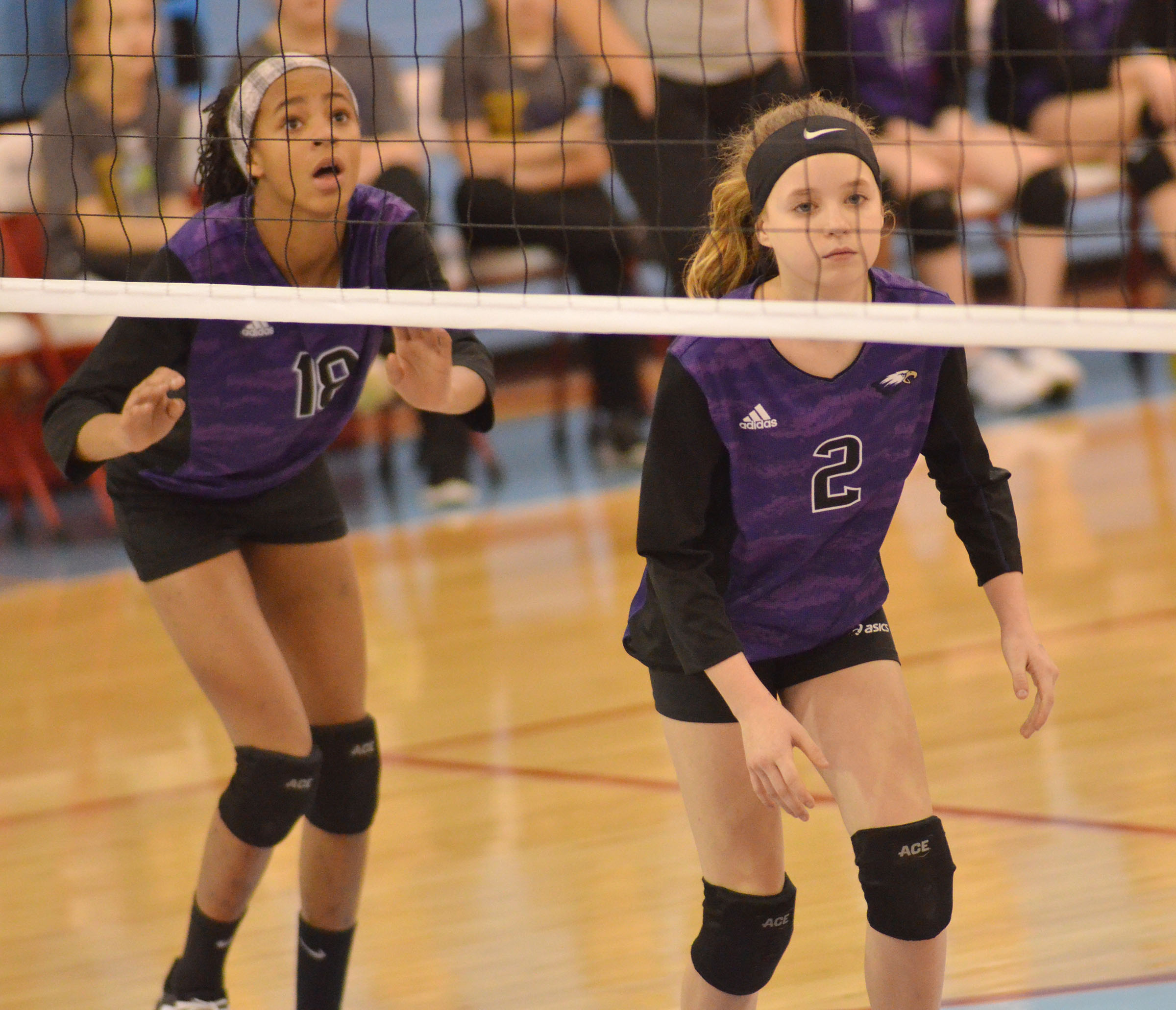 CMS seventh-graders Aundaya Coleman, at left, and Rylee Petett watch the ball.