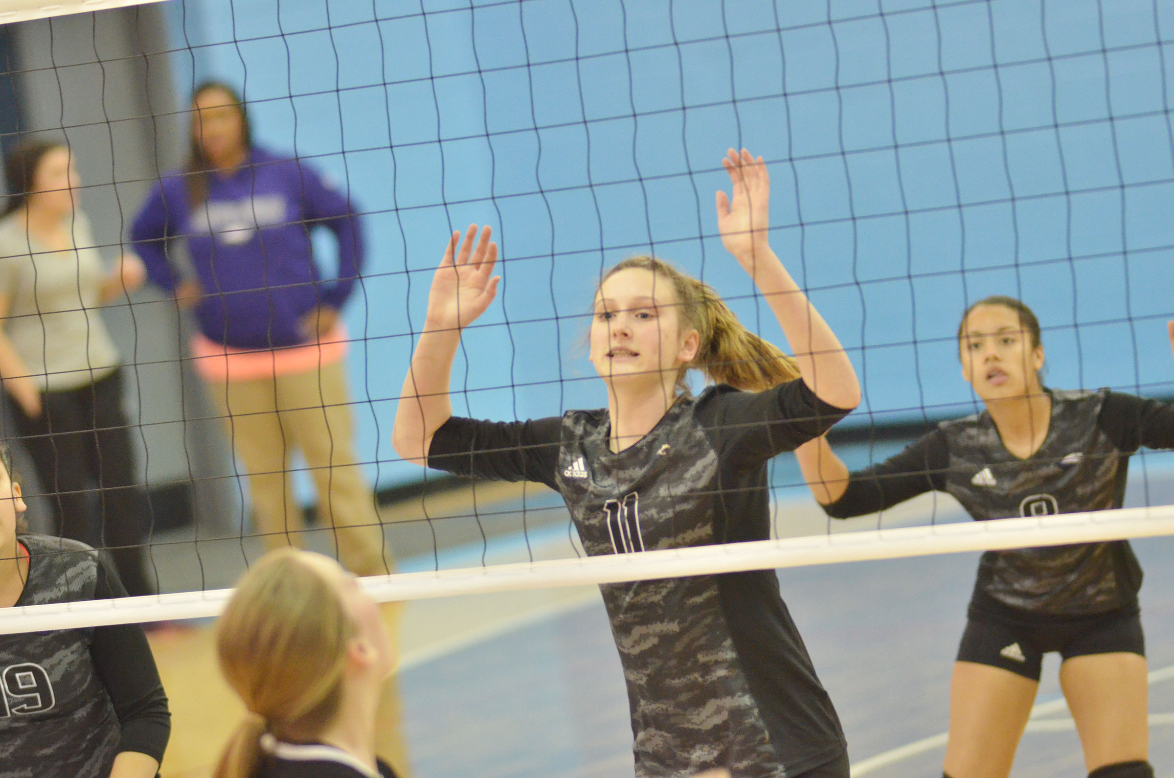 CMS eighth-graders Zoie Sidebottom, at left, and Laci Hodgens watch the ball.