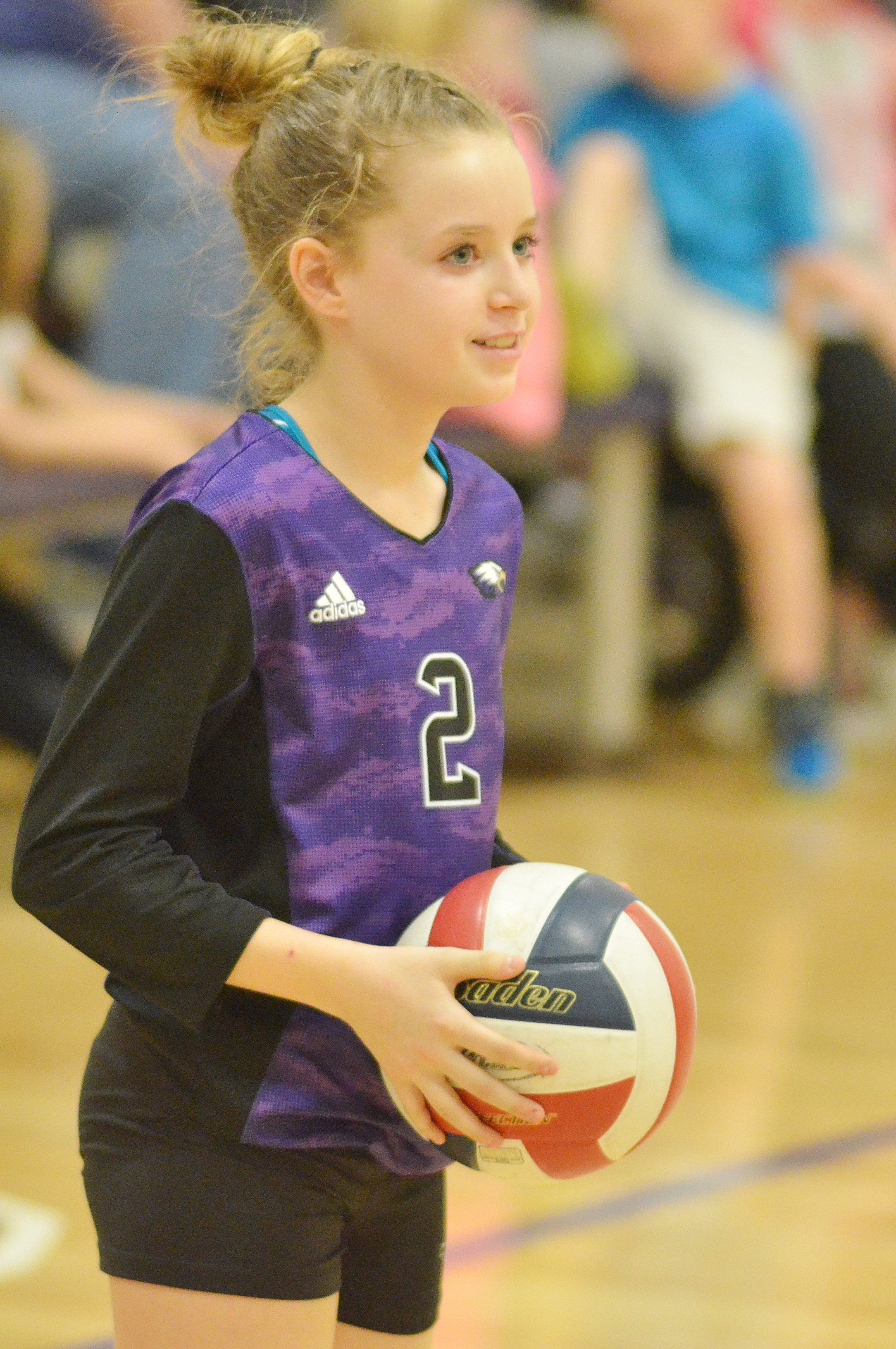CMS seventh-grader Rylee Petett smiles as she gets set to serve.