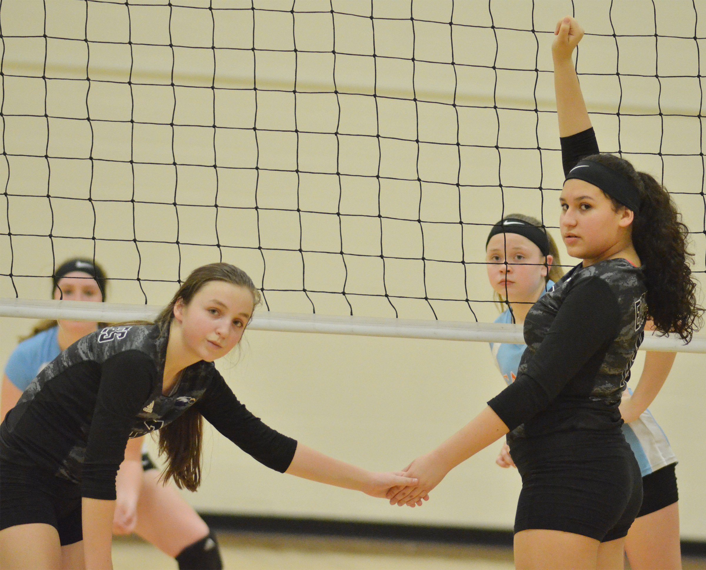 CMS seventh-grader Lainey Watson, at left, and eighth-grader Anna Clara Moura get ready for the serve.