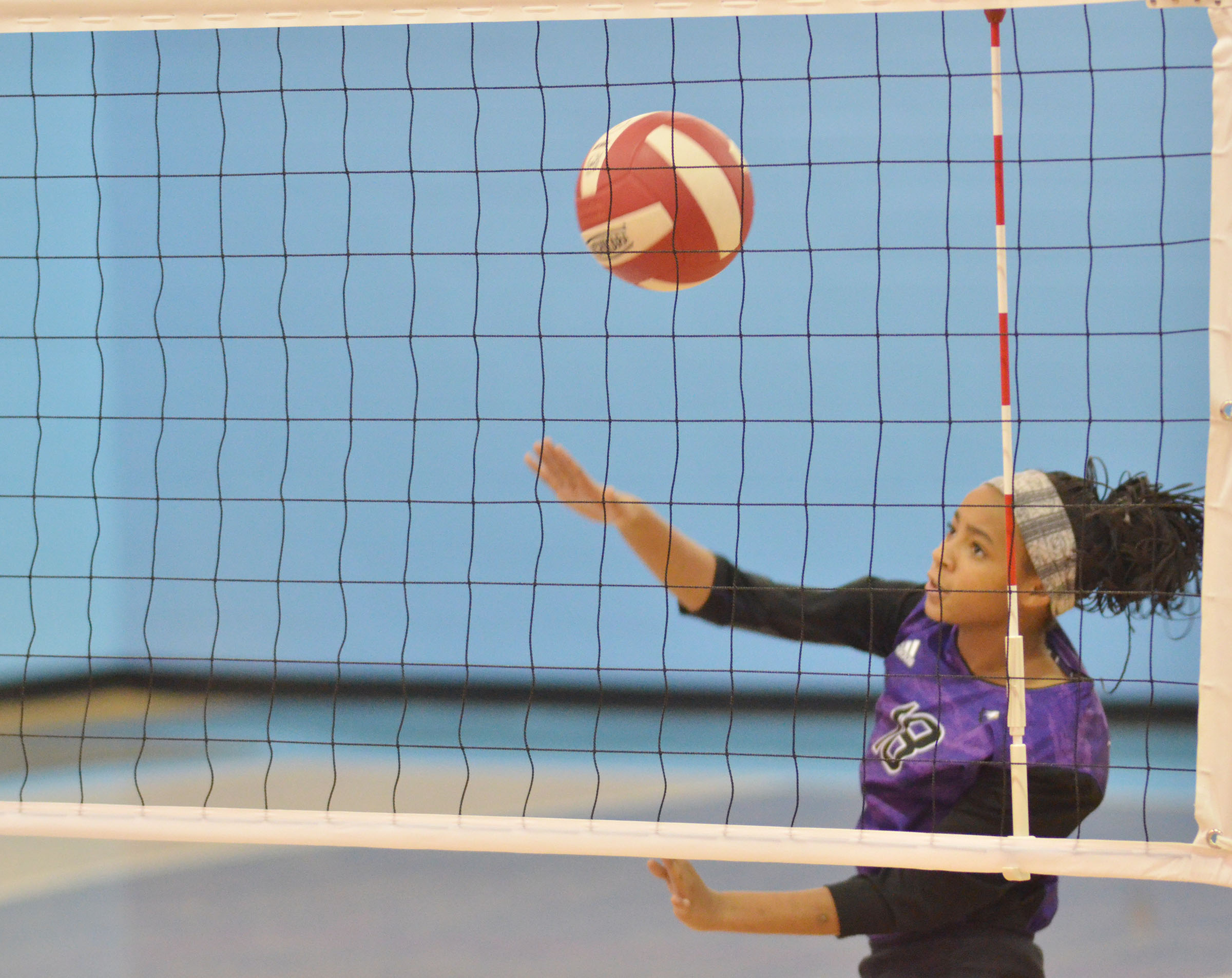 CMS seventh-grader Aundaya Coleman hits the ball over the net.
