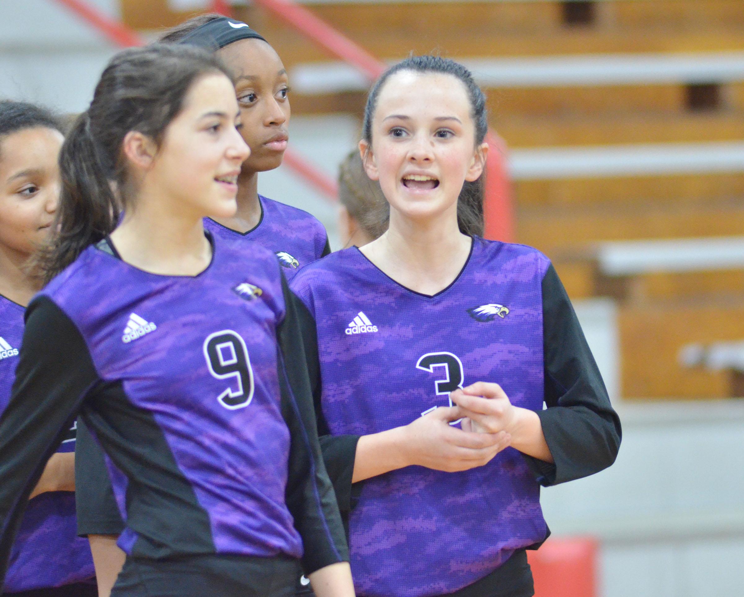 CMS seventh-grader Sarah Adkins talks to her teammates before the match.