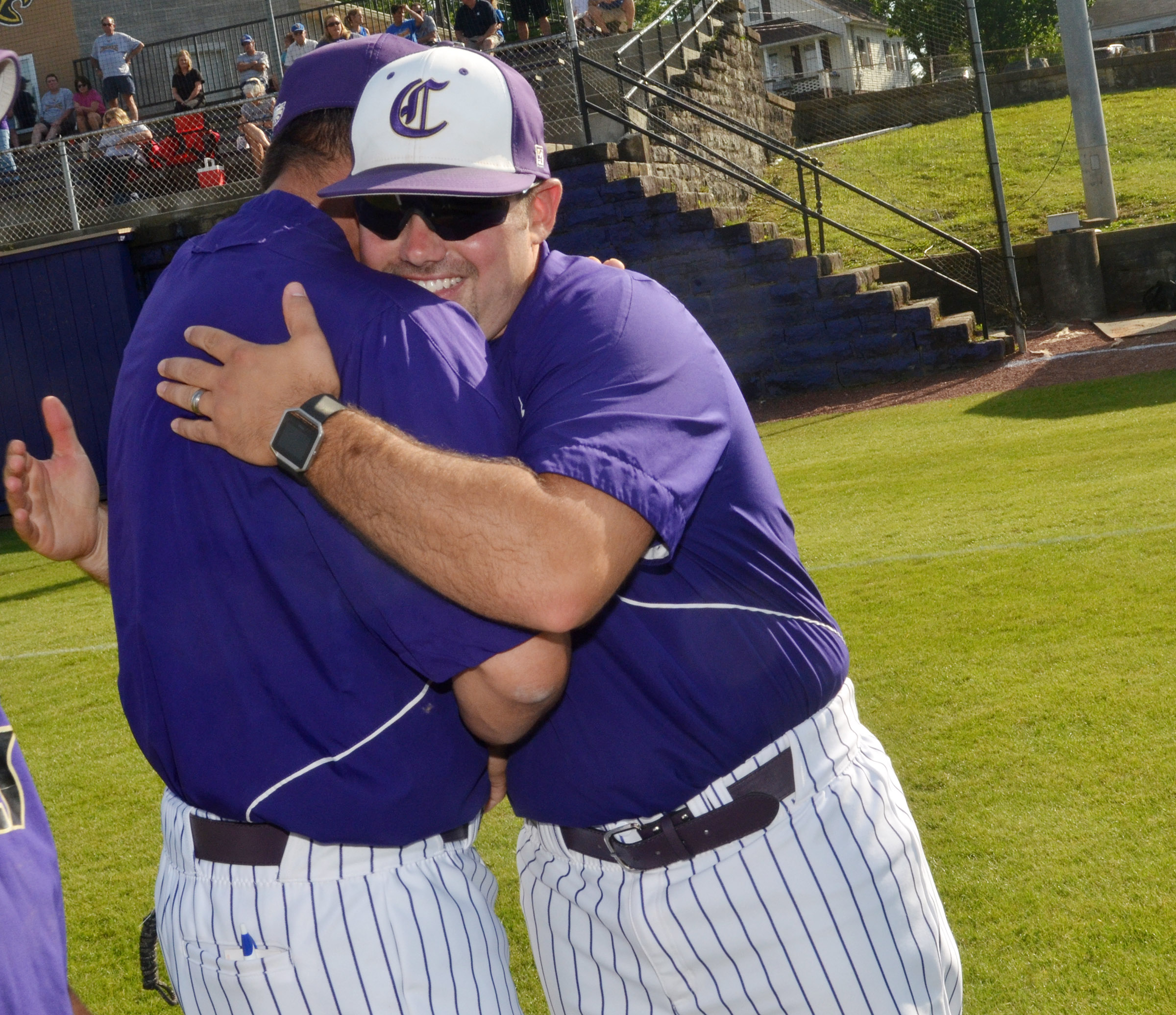 Blake Milby, a former CHS baseball player and assistant coach, has been named head coach. He succeeds Kirby Smith, who coached for 11 years and is now superintendent. Above, Milby hugs Smith after a ceremony honoring Smith for his dedication to the CHS baseball program.