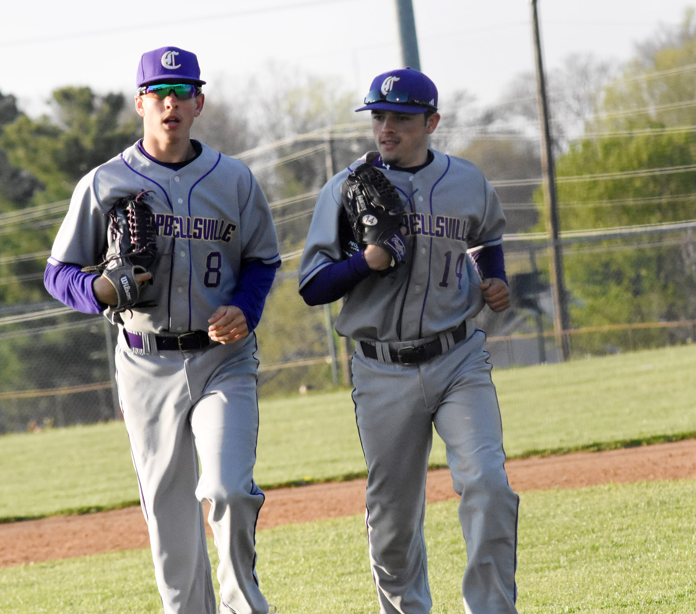 CHS freshman John Orberson, at left, and junior Ryan Kearney run to the dugout.