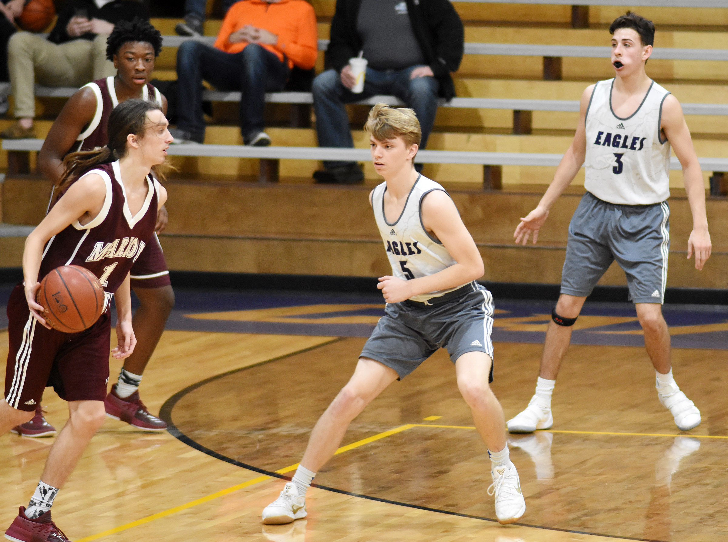 CHS freshman Arren Hash, center, and John Orberson play defense.