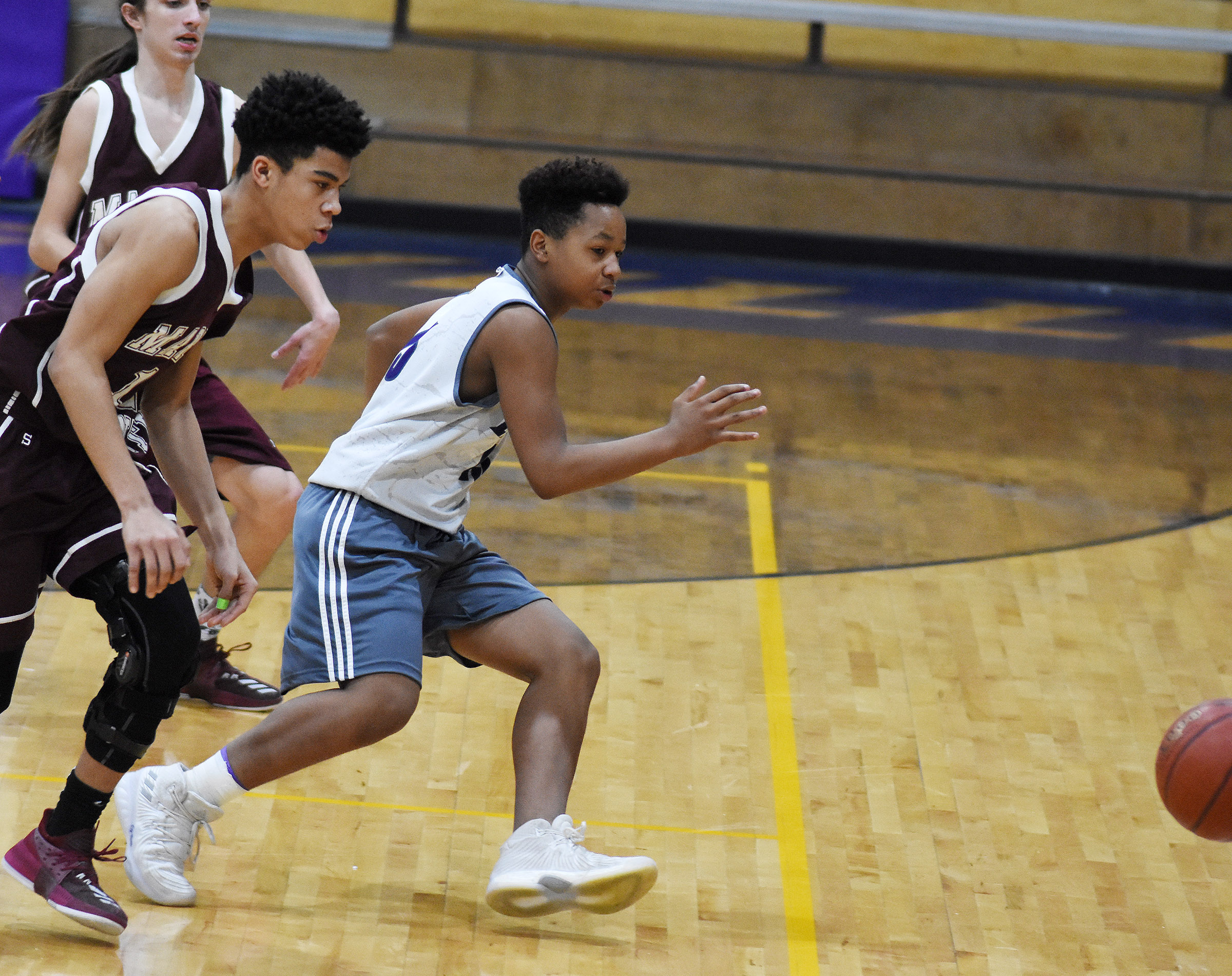 Campbellsville Middle School seventh-grader Deondre Weathers goes for the ball.